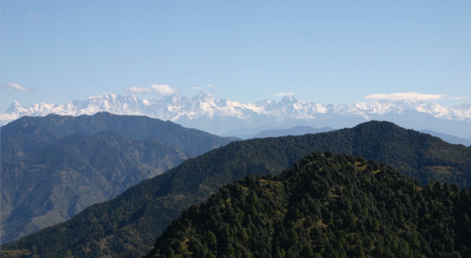 Meena and Dadi's beloved mountains, as seen from Sister's Bazaar. Uttarakhand, India. The foothills of the Himalayas, the youngest and highest mountains in the world.