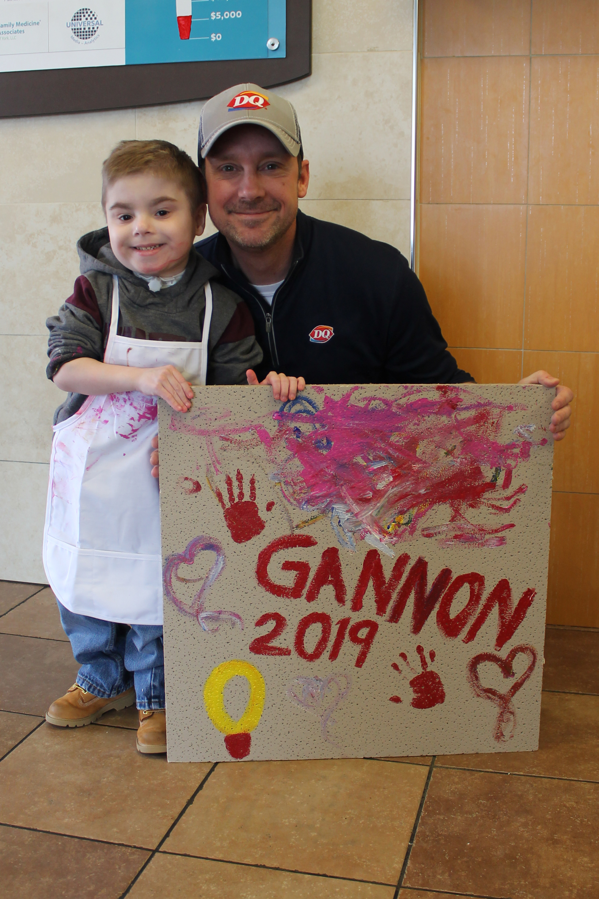 Gannon and John Miller at DQ Roosevelt. Gannon just finished painting his ceiling tile as the official DQ Roosevelt Miracle of 2019!