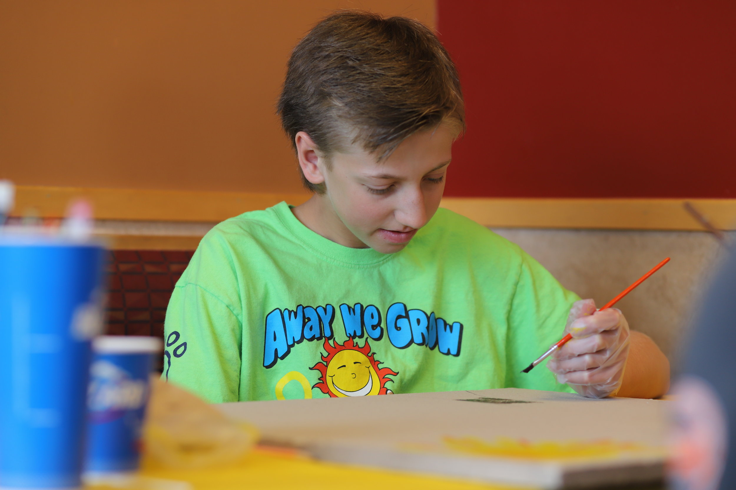 Corbin painting his tile at DQ
