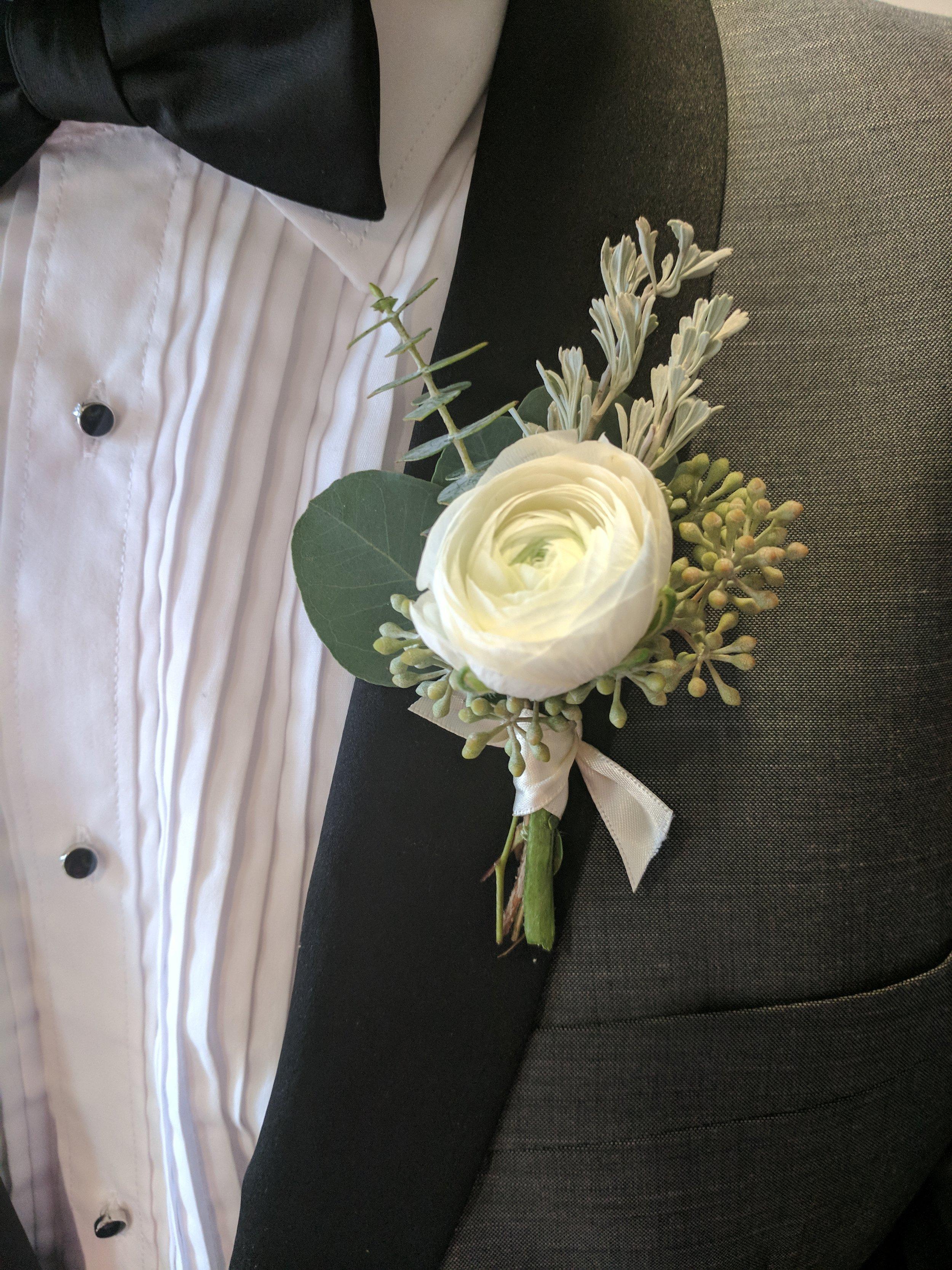 White Ranunculus and Greenery Boutonniere.jpg