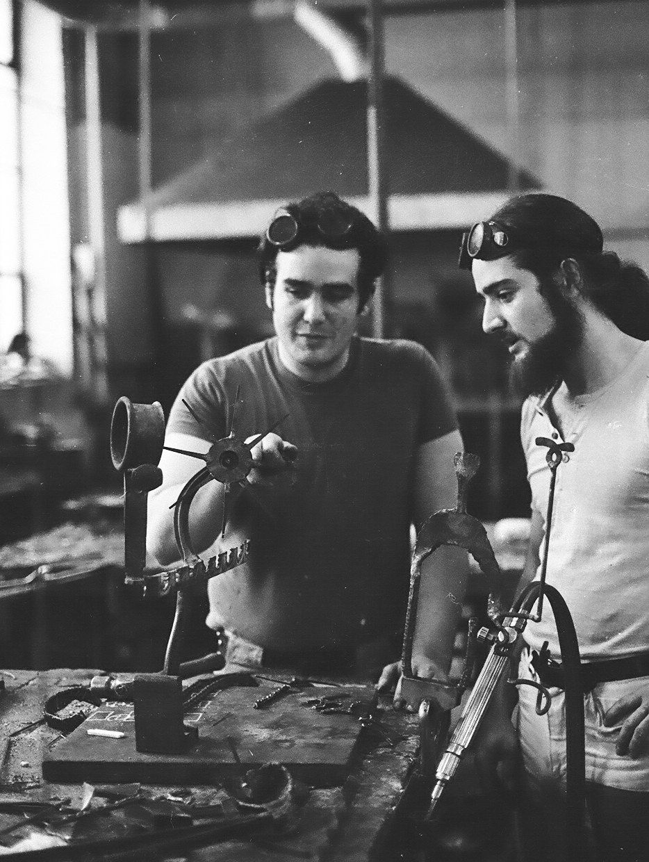 Michael Malpass working with a student while teaching at Pratt Institute.