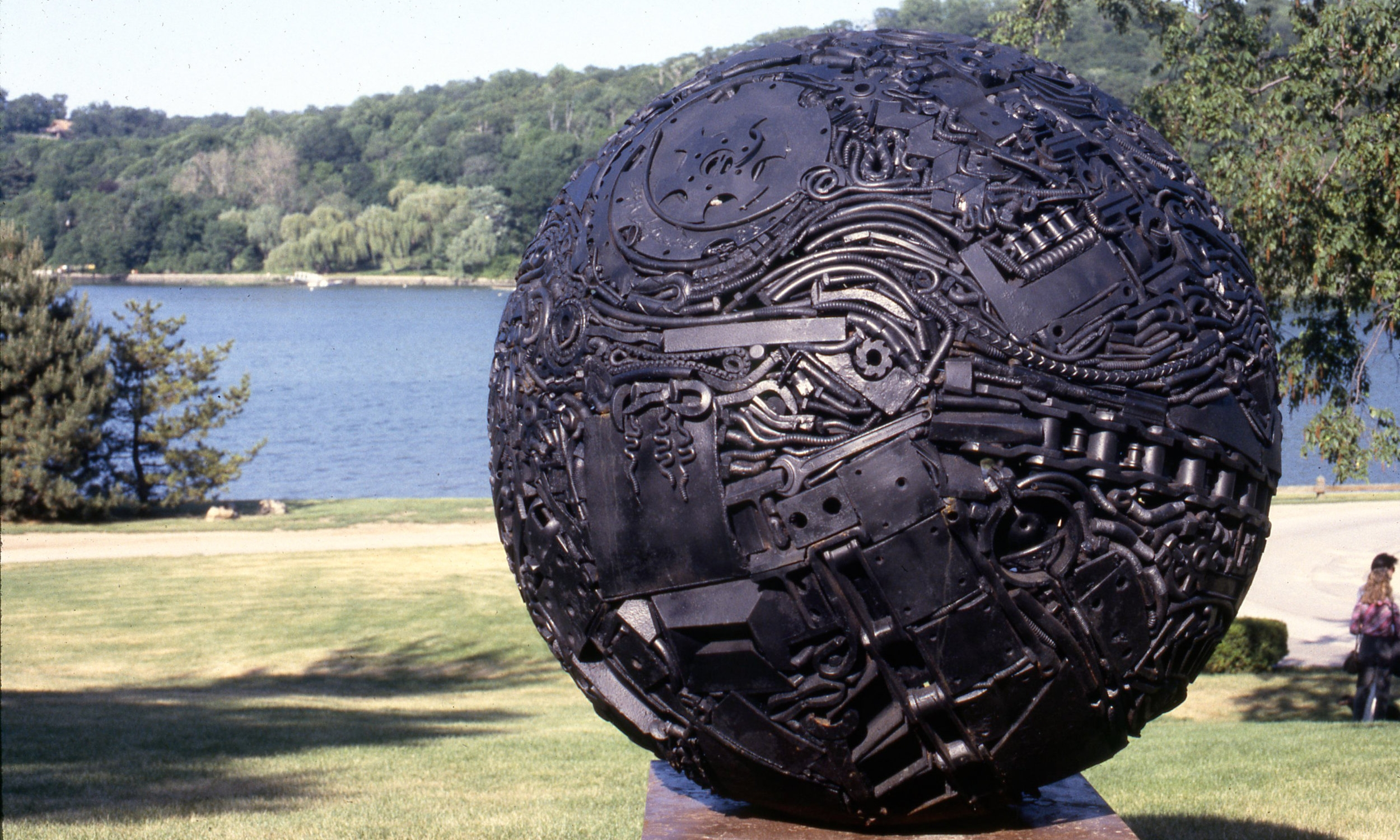 """Midnight Fair"" by Michael Malpass, 1980. 5' diameter forged and welded steel sphere. Installation at Cold Spring Harbor Science Laboratory, Cold Spring Harbor, NY."