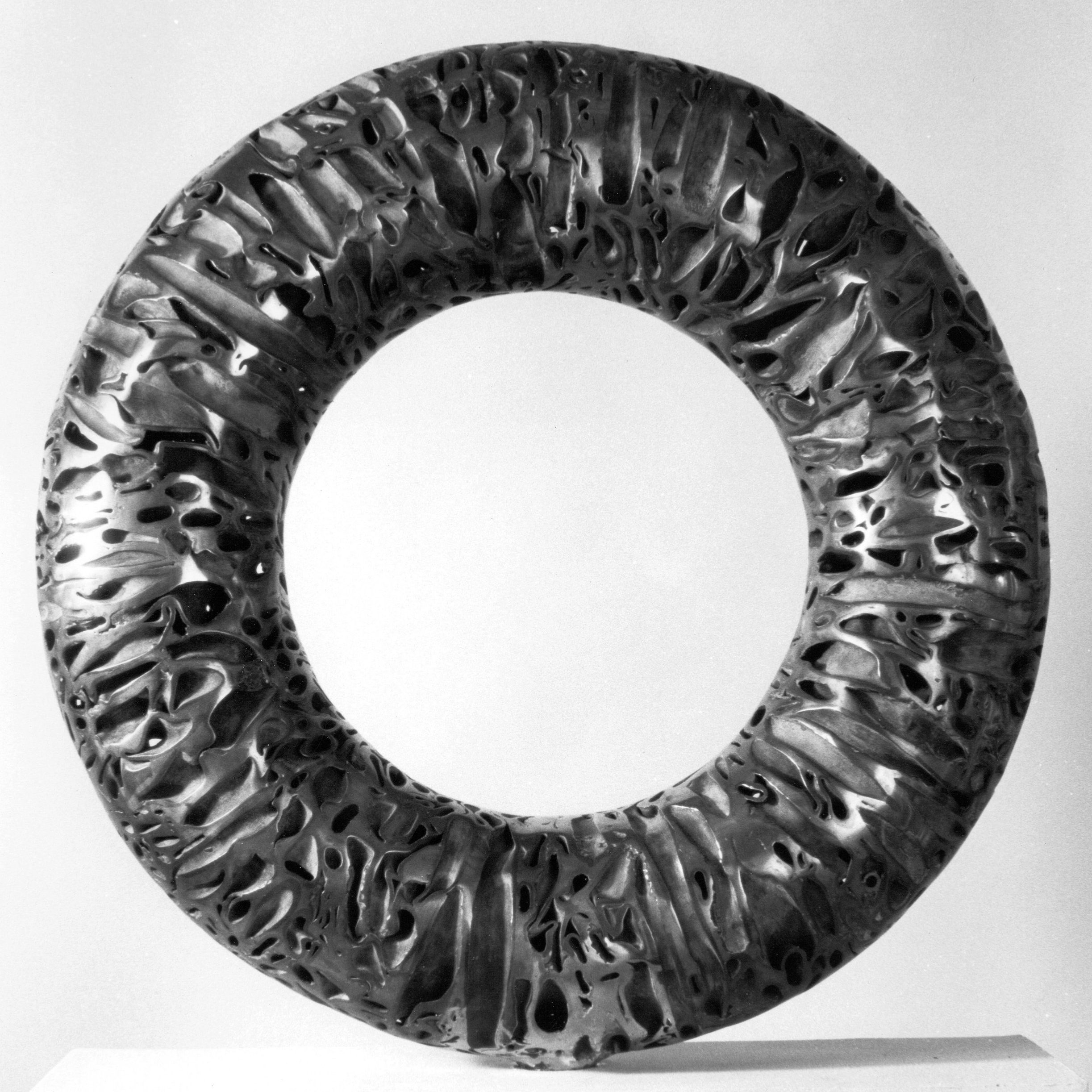 """O"" by Michael Malpass, 1987. 32"" diameter sliced copper pipe and bronze. Installation at the Ocean County Library, Toms River, NY."
