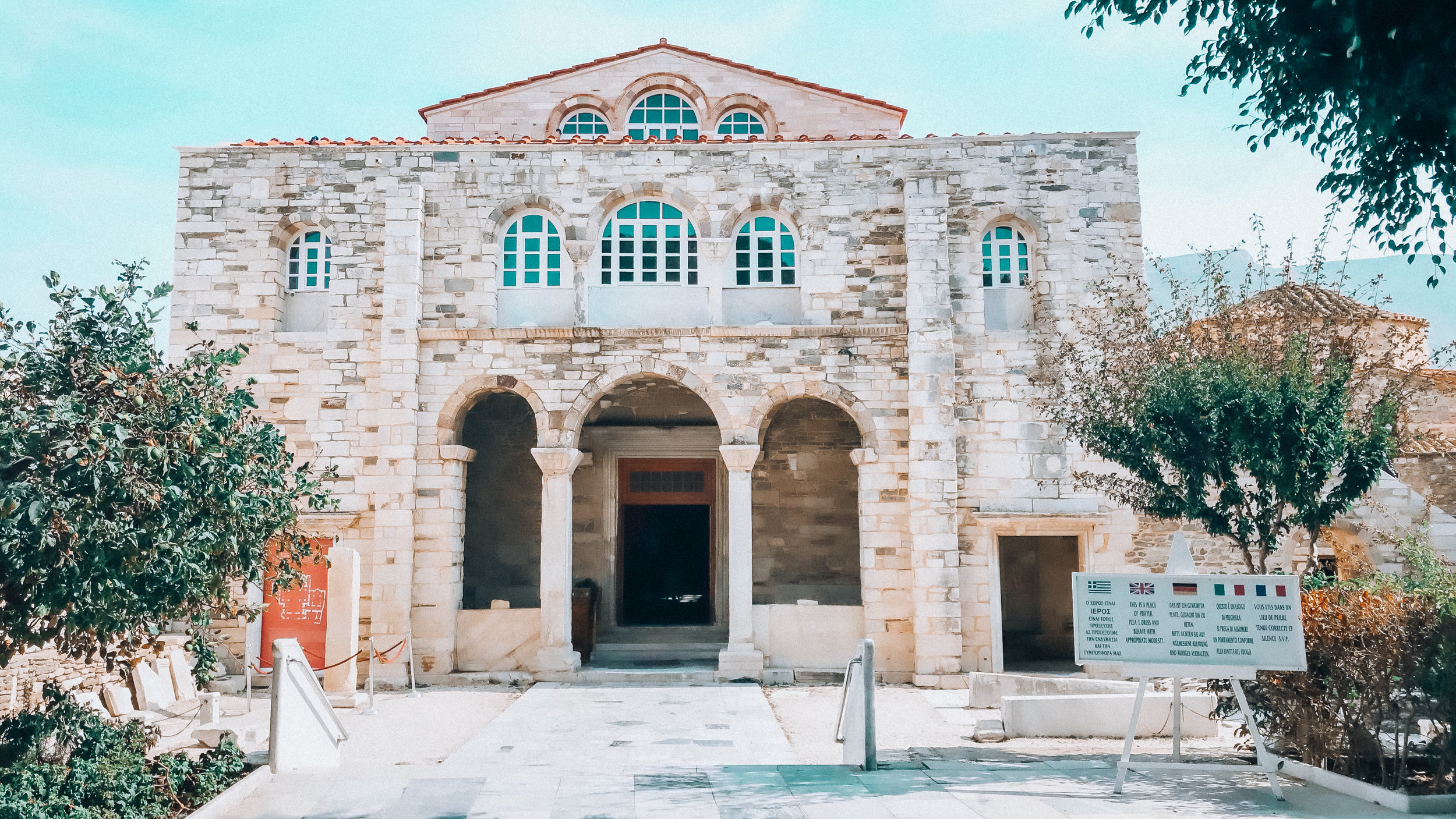 2 miles from the sea on a hill in Parrikia lies Ekatontapiliani, The Church of 100 Doors (Paros, Greece).Originally it was a 4th century temple to Aphrodite, the Greek Goddess of love and there are still original columns from.
