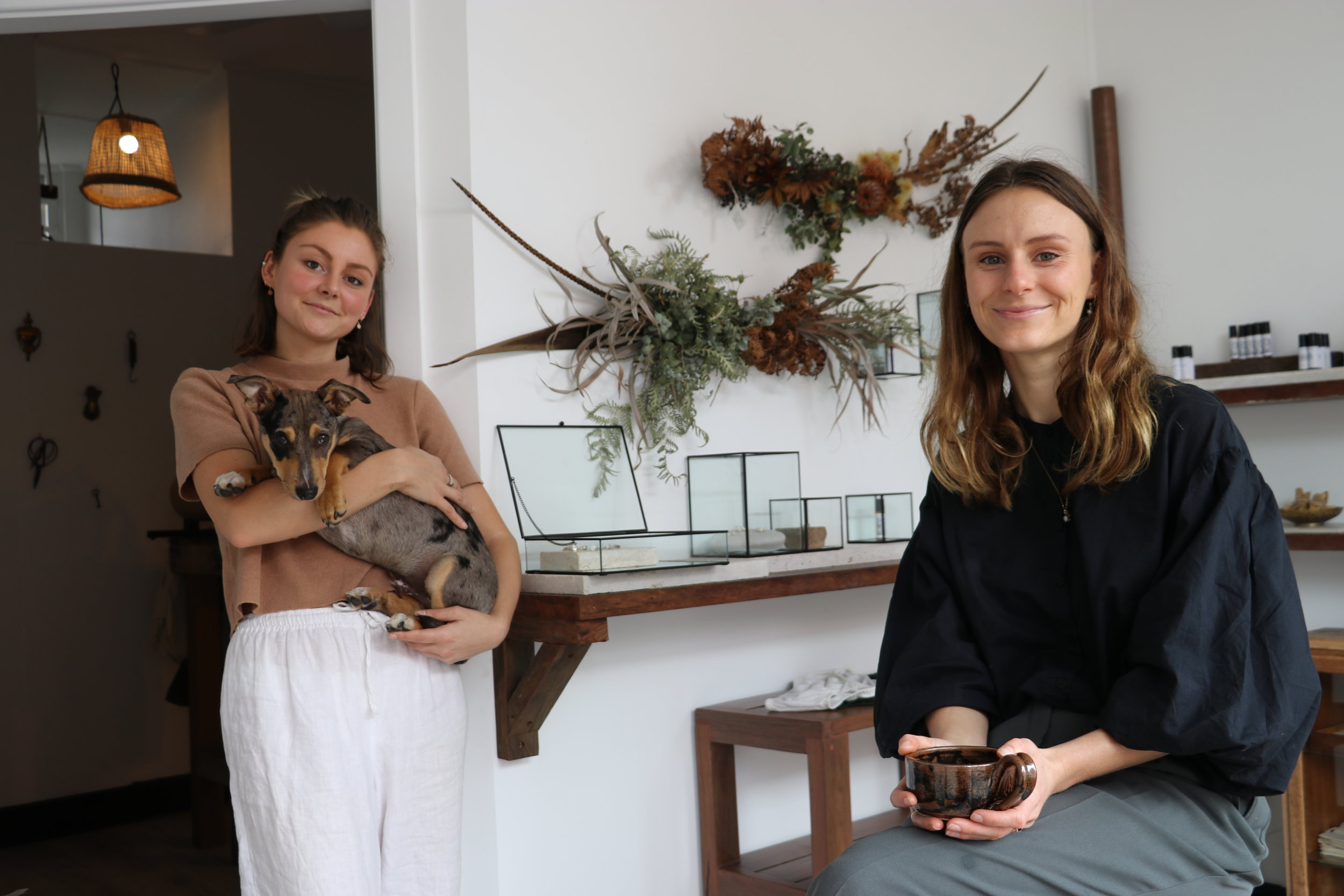 Morgan Kerr (left) with Leo the puppy and Gab Abell seated