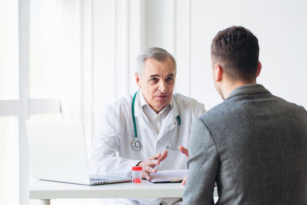 A doctor consulting with his patient