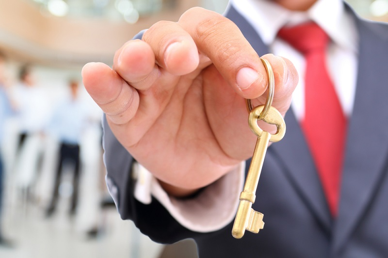 A man holding A key