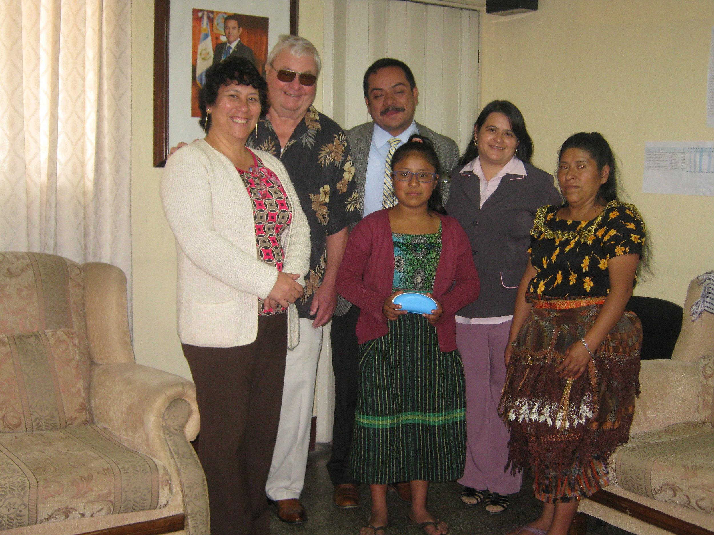 Karen Estefania Tepaz Coroy Receives Her Prescription Glasses from Gordon Flattum of VRI