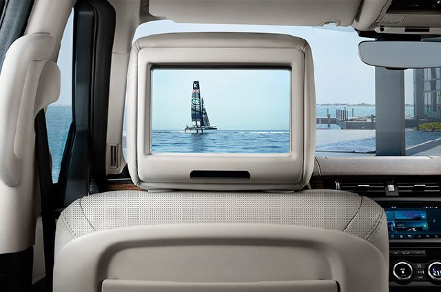 """Rear Seat Entertainment System features two 8"""" screens in the headrests and can play movies and TV channels including digital"""