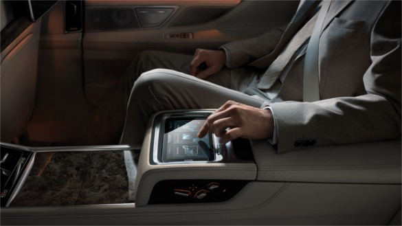 """The BMW Touch Command is a tablet with 7"""" display that is integrated into the centre armrest in the rear."""