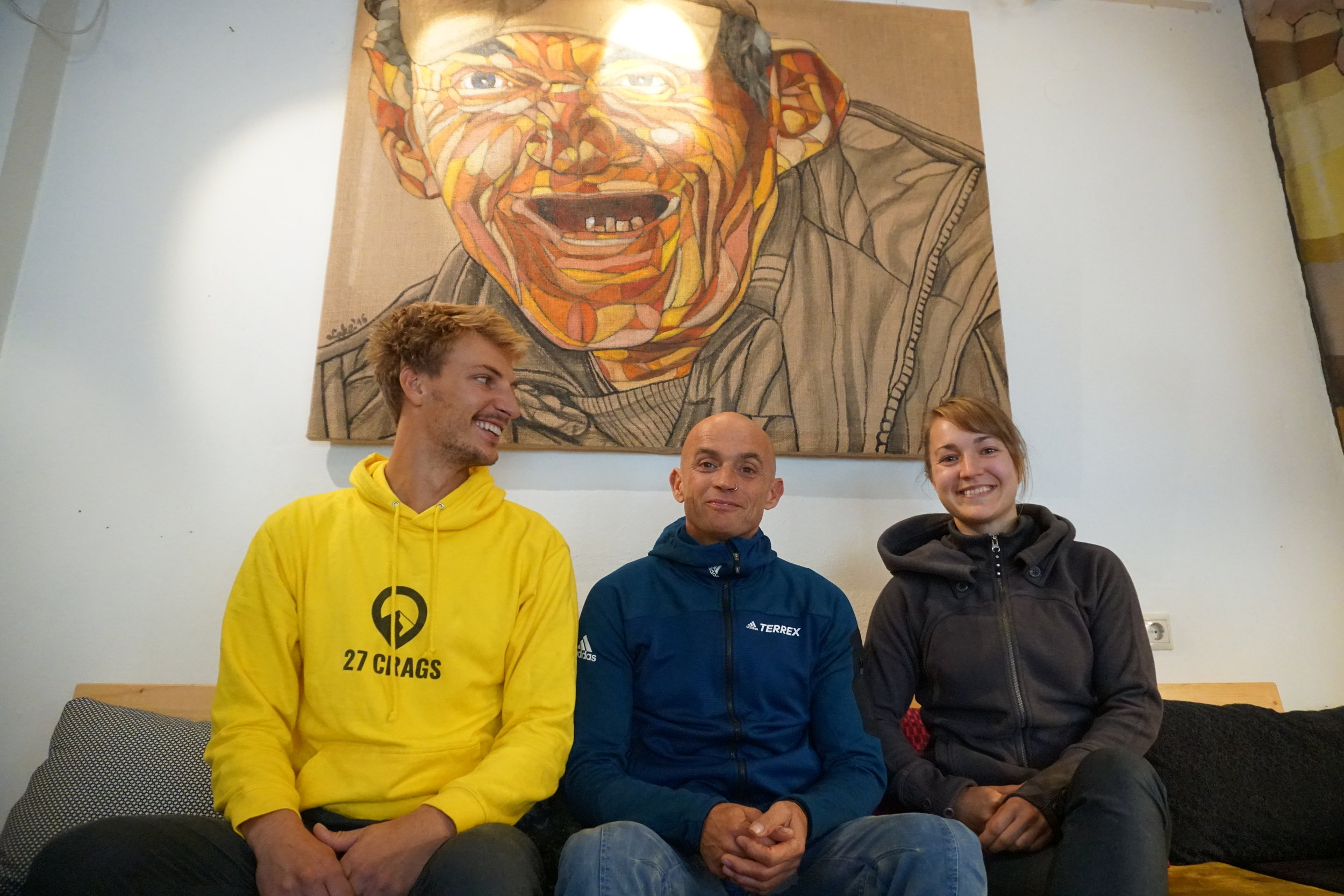 Dicki Korb in a cafeteria in Leonidio and Tim and Hanna from 27 Crags next to him.