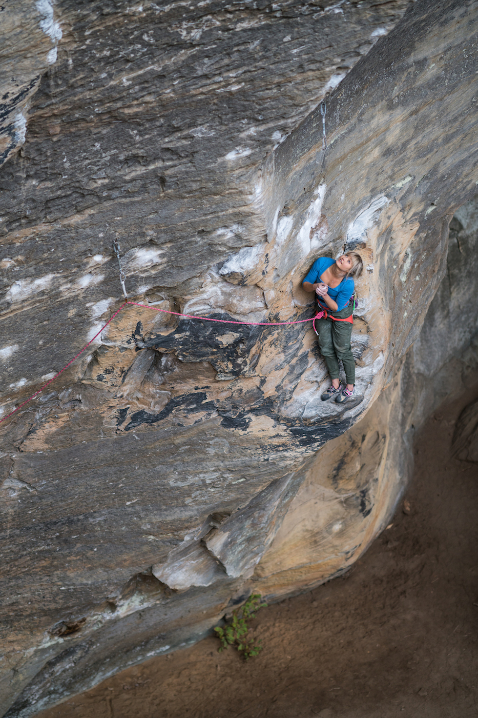 Anna warming her hands on a route at Red River Gorge. Photo: Matty Hong.
