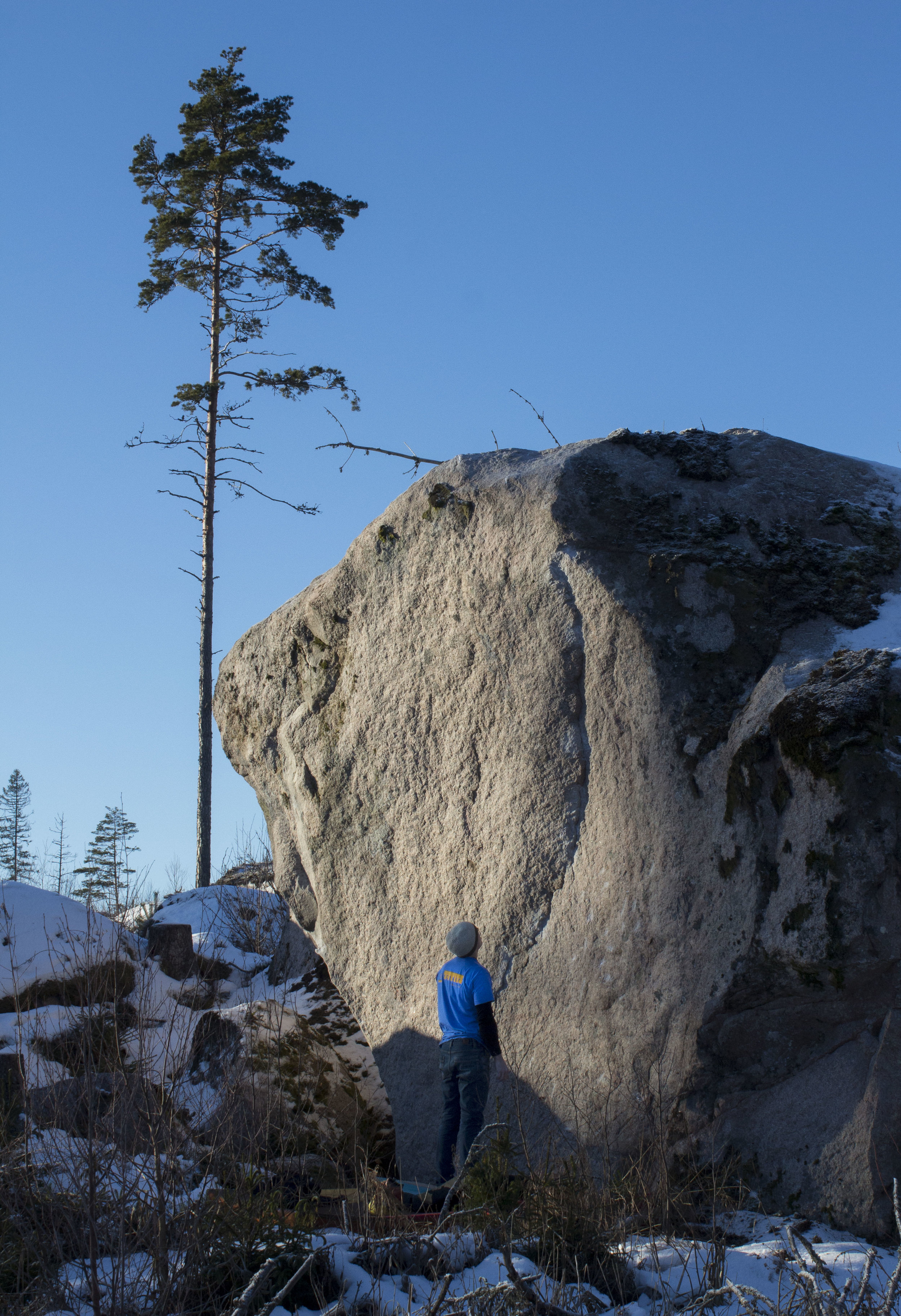 "Jimmy Karlsson looks up on his first ascent  ""Drömfabriken"" 7B  in the area of Uppsala. Photo by Anna Hassel"