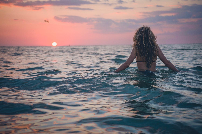 swim-ocean-sunset-woman.jpg