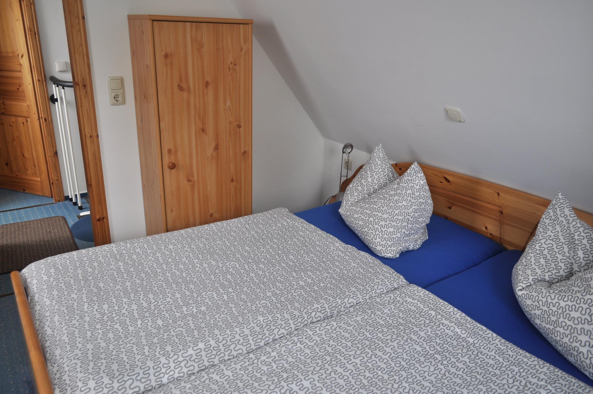 Obergeschoss 1. Schlafzimmer mit Doppelbett