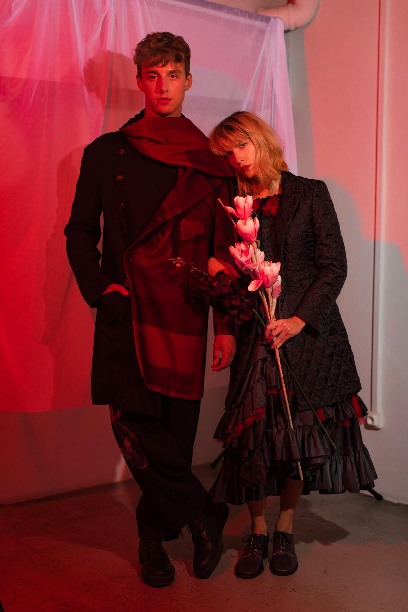 HIM: COAT & PANTS by YOHJI YAMAMOTO  HER: DRESS & SHOES by COMME DES GARCONS