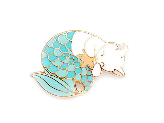 by OhPlesiosaur - If you love enamel pins, your not alone. OhPlesiosaur creates some real charmers, T-rex in a sweater? Sure. Purrmaids. Definitely. Explore them here.