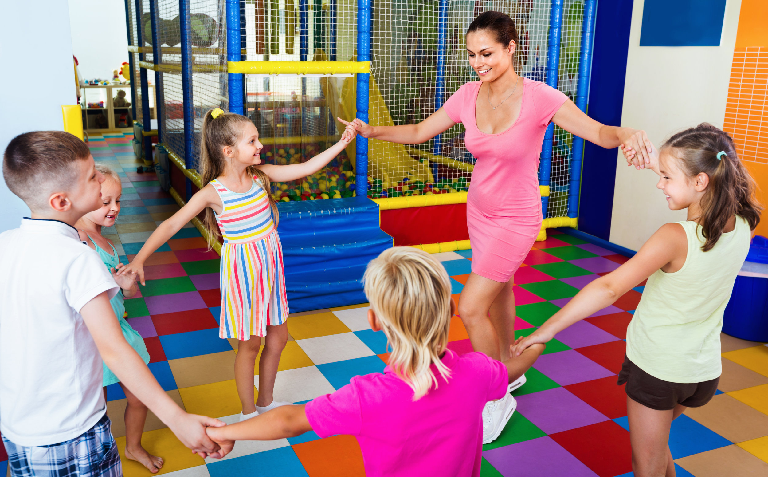 teacher dancing with kids.jpg