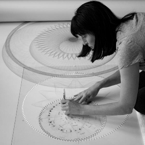 Mary Wagner working on a large-scale drawing in the studio.