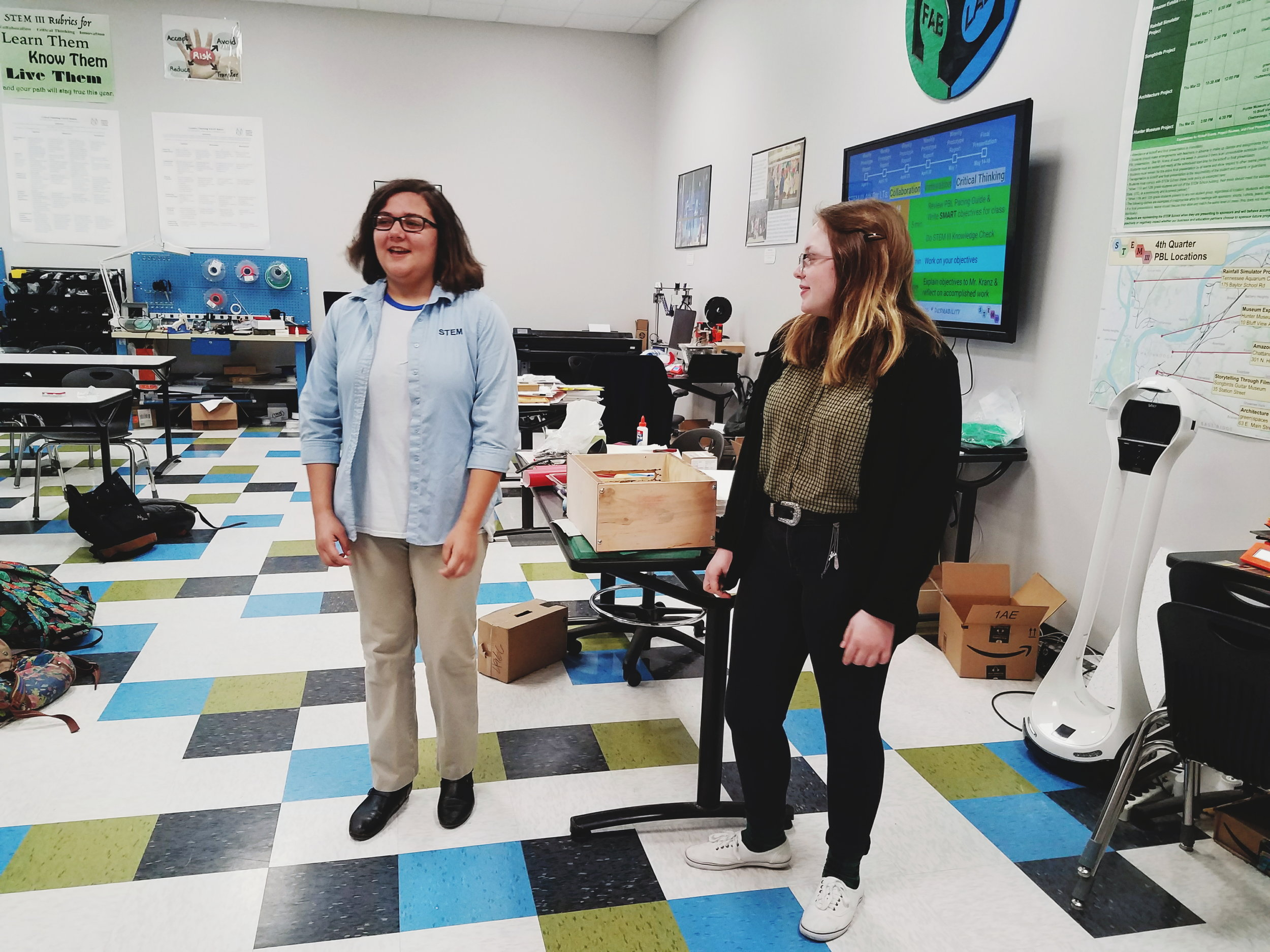 STEM School students give visitors a tour of the school's FabLab.