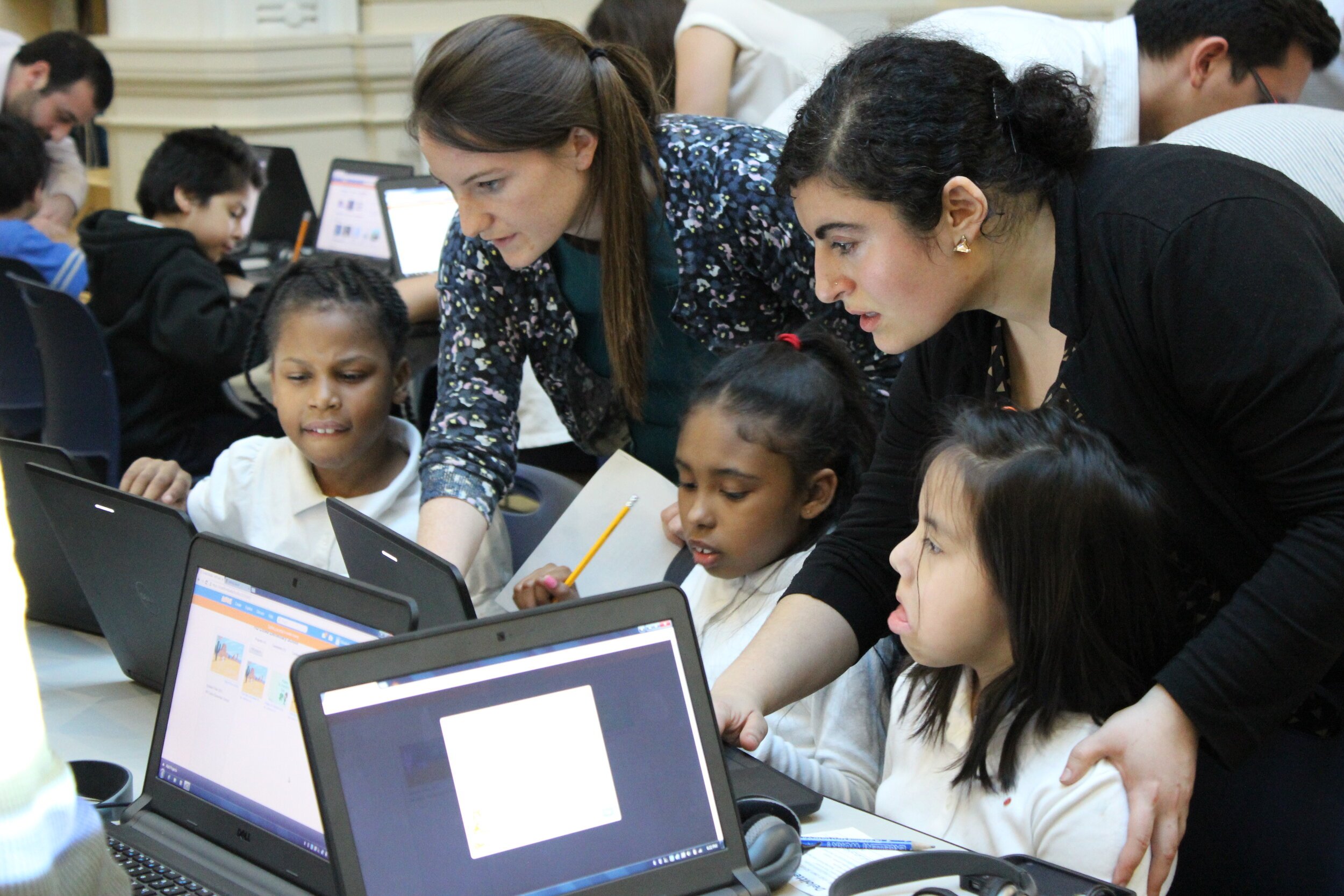 Flora Lerenman, a DC educator and America Achieves Fellow, works with her students.