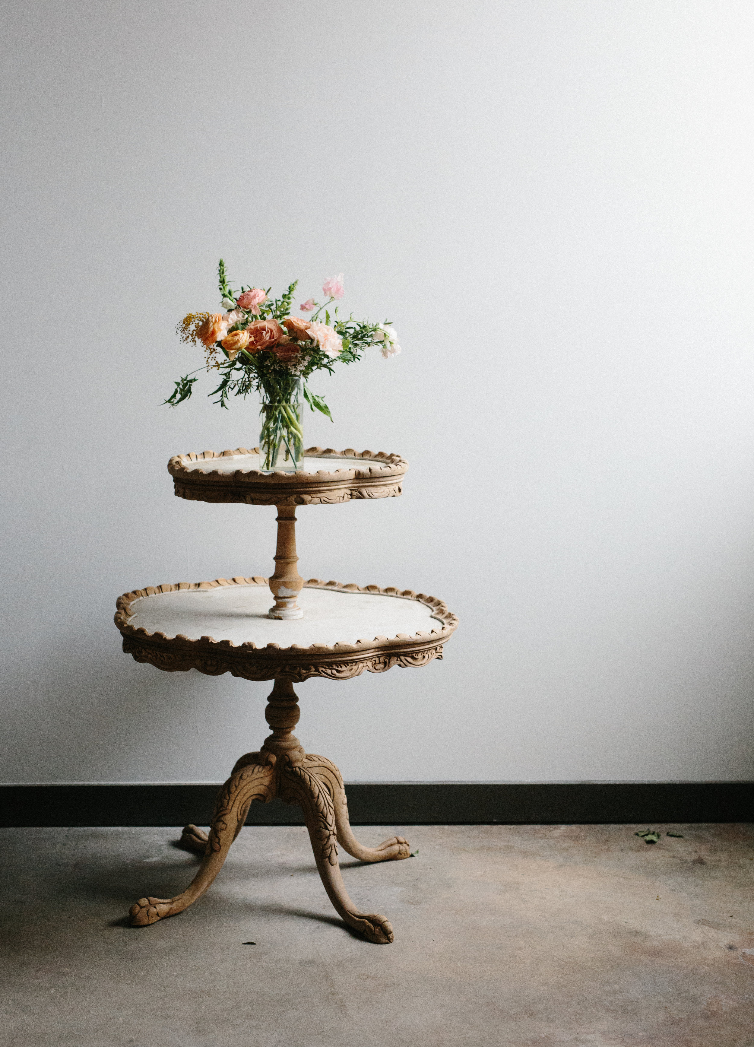 HAND CARVED CAKE TABLE // $55