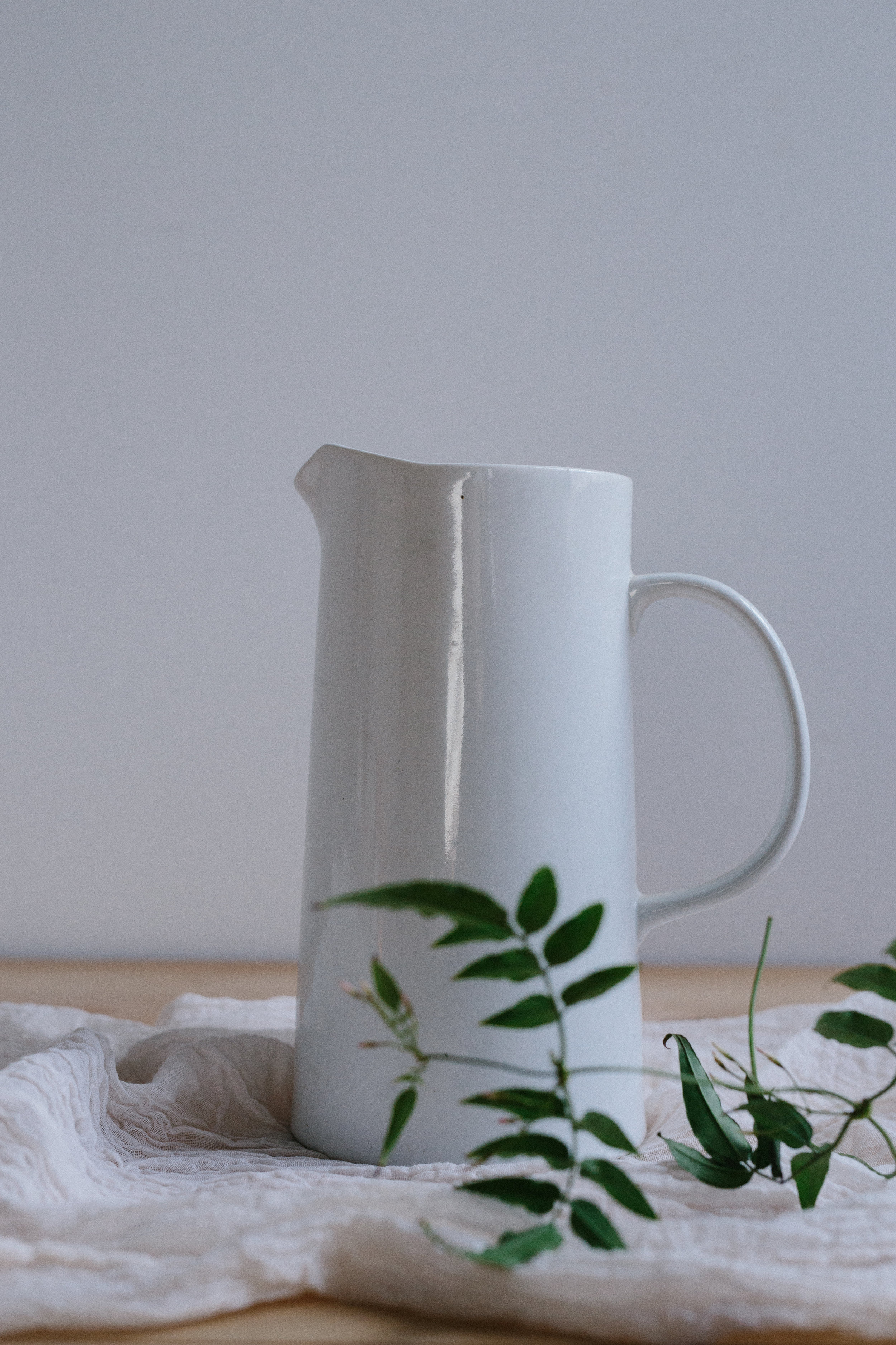 LARGE WHITE CERAMIC PITCHER // $8