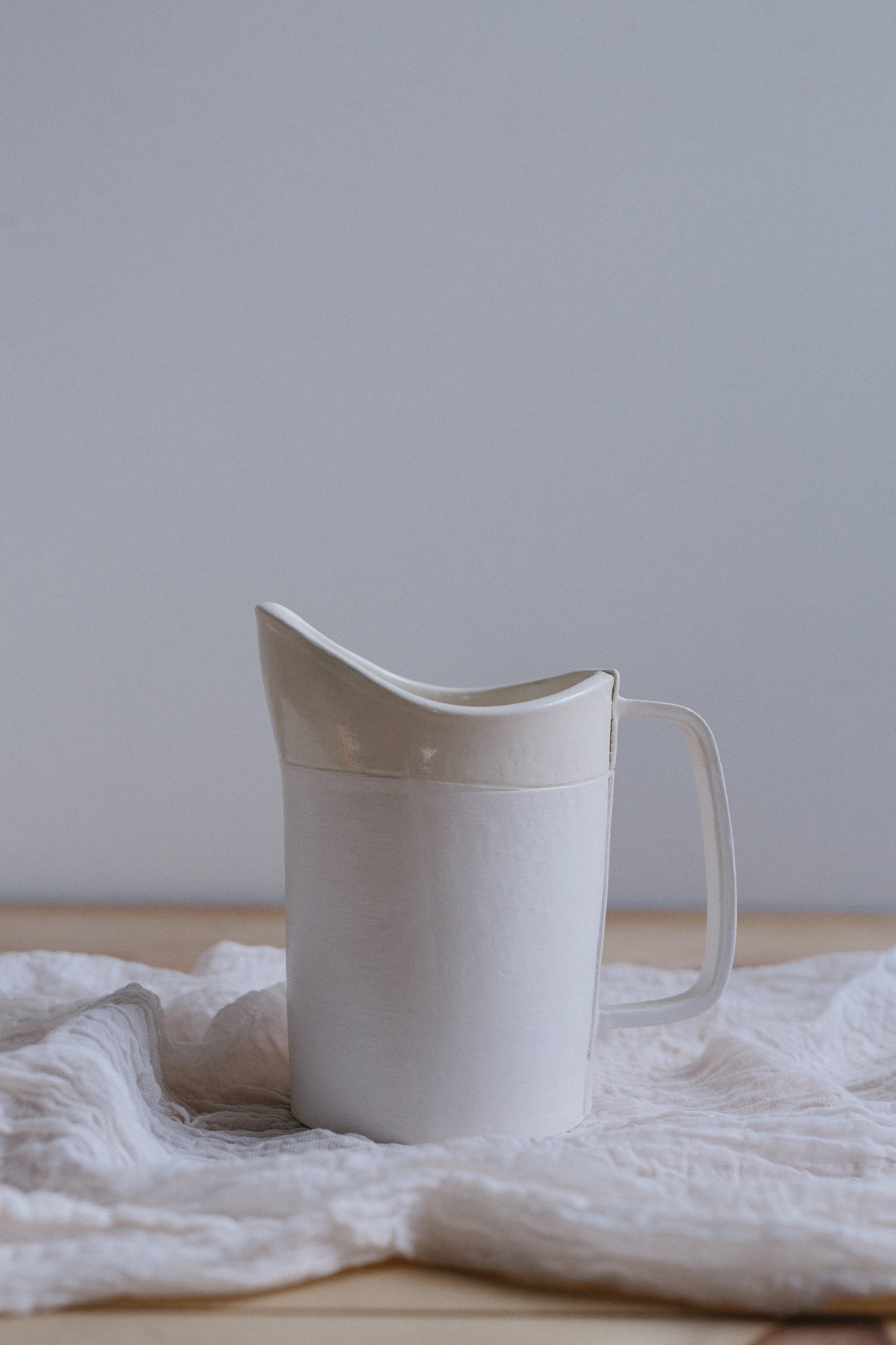 SMALL WHITE CERAMIC PITCHER // $6