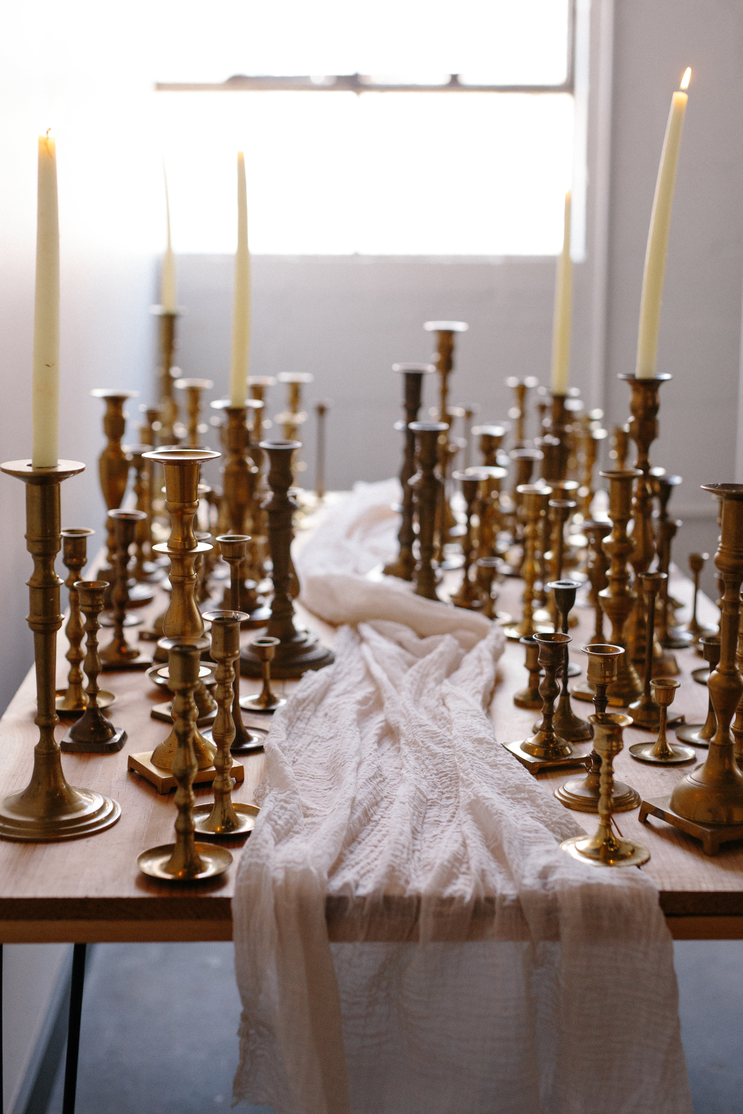 BRASS CANDLESTICK HOLDERS // $1 EACH  We do offer a cleaning service for wax residue at an additional charge of $1 per candlestick  100+ available