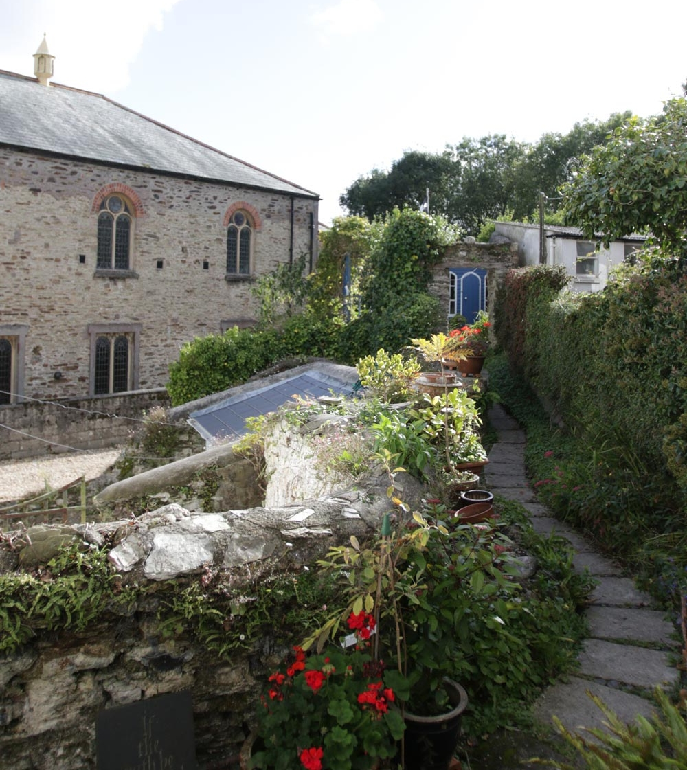 A view of the Fosters' garden—parts of their stone home may be up to 1,000 years old.   Photo by Dan Saal
