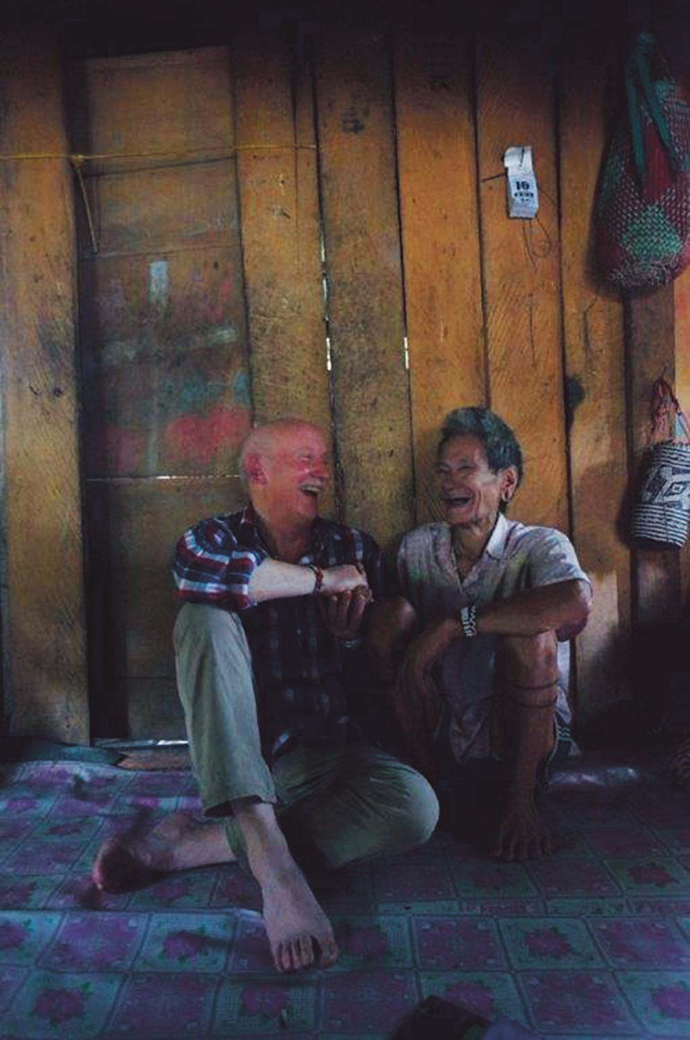 Tony Foster and Penan tribesman Nyapun share a laugh together, Mulu, Borneo, February/March 2015. Photo:Alison Pritchard
