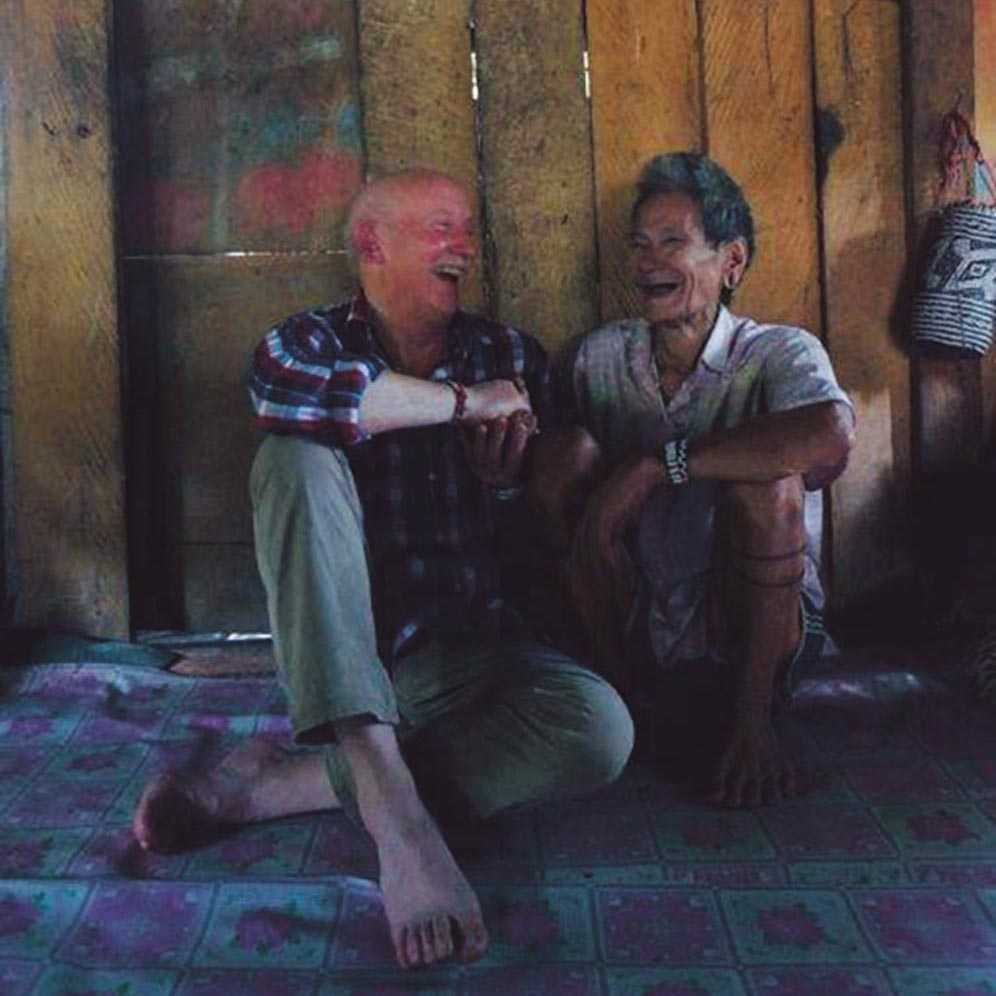 Tony Foster and Penan elder tribesman Nyapun share a laugh together, Mulu, Borneo, February/March 2015. Photo by Alison Pritchard