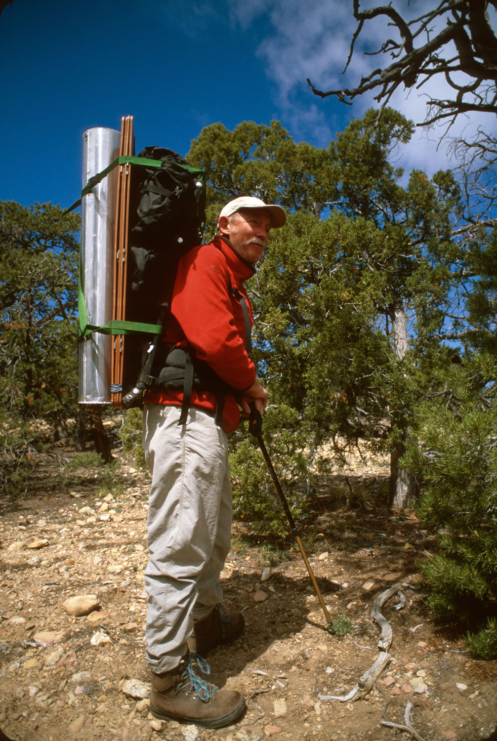 Tony Foster backpacking with equipment in the Grand Canyon. Courtesy of Foster Art & Wilderness Foundation.