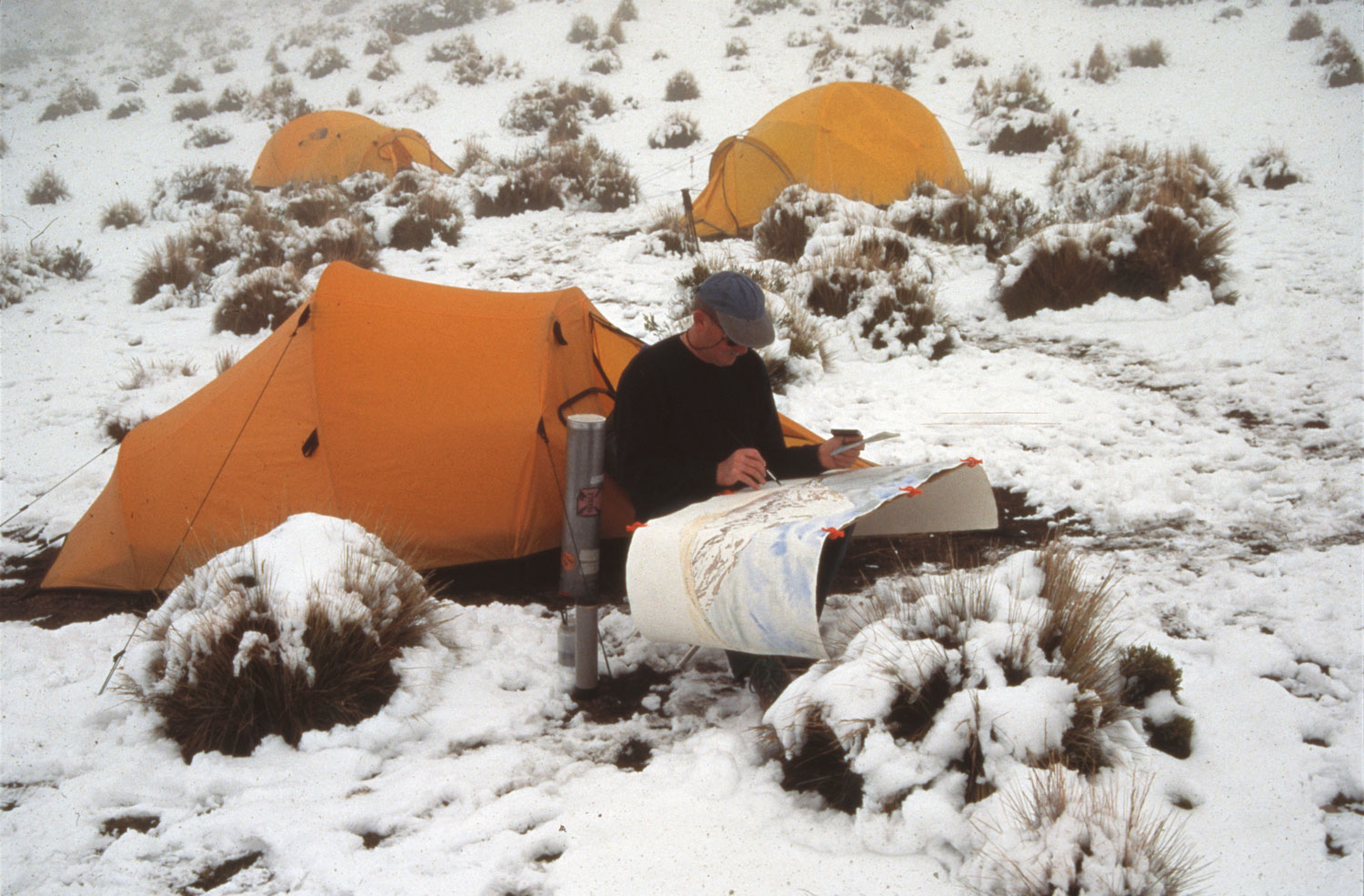 Tony Foster painting the volcano Nevado Sajama, Bolivia. 1997. Photo by Bill Vanderbilt. Courtesy of Foster Art & Wilderness Foundation.