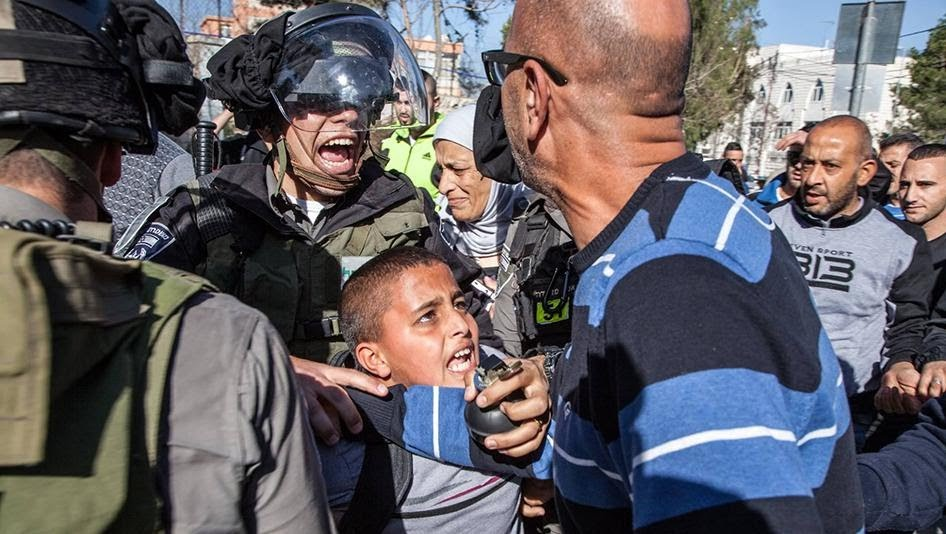 Israeli border police arresting Ahmad Abu Sbitan, 11-years-old, in front of his school in East Jerusalem. The police accused him of throwing a stone at them. © Majd Gaith