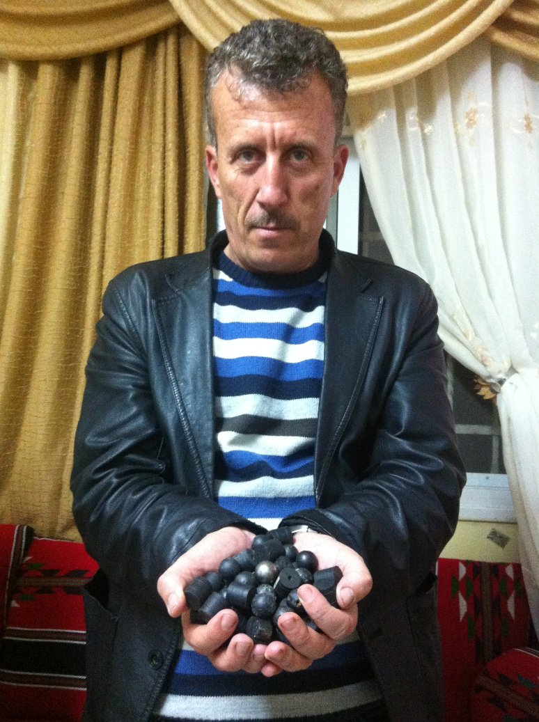 Bassem Tamimii hold rubber-coated steel bullets that Israeli border police and soldiers fired at residents of Nabi Saleh.
