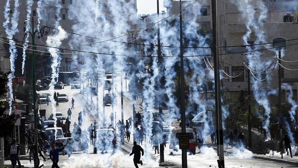 Border Police shoot tear gas at Palestinian protesters in Bethlehem.