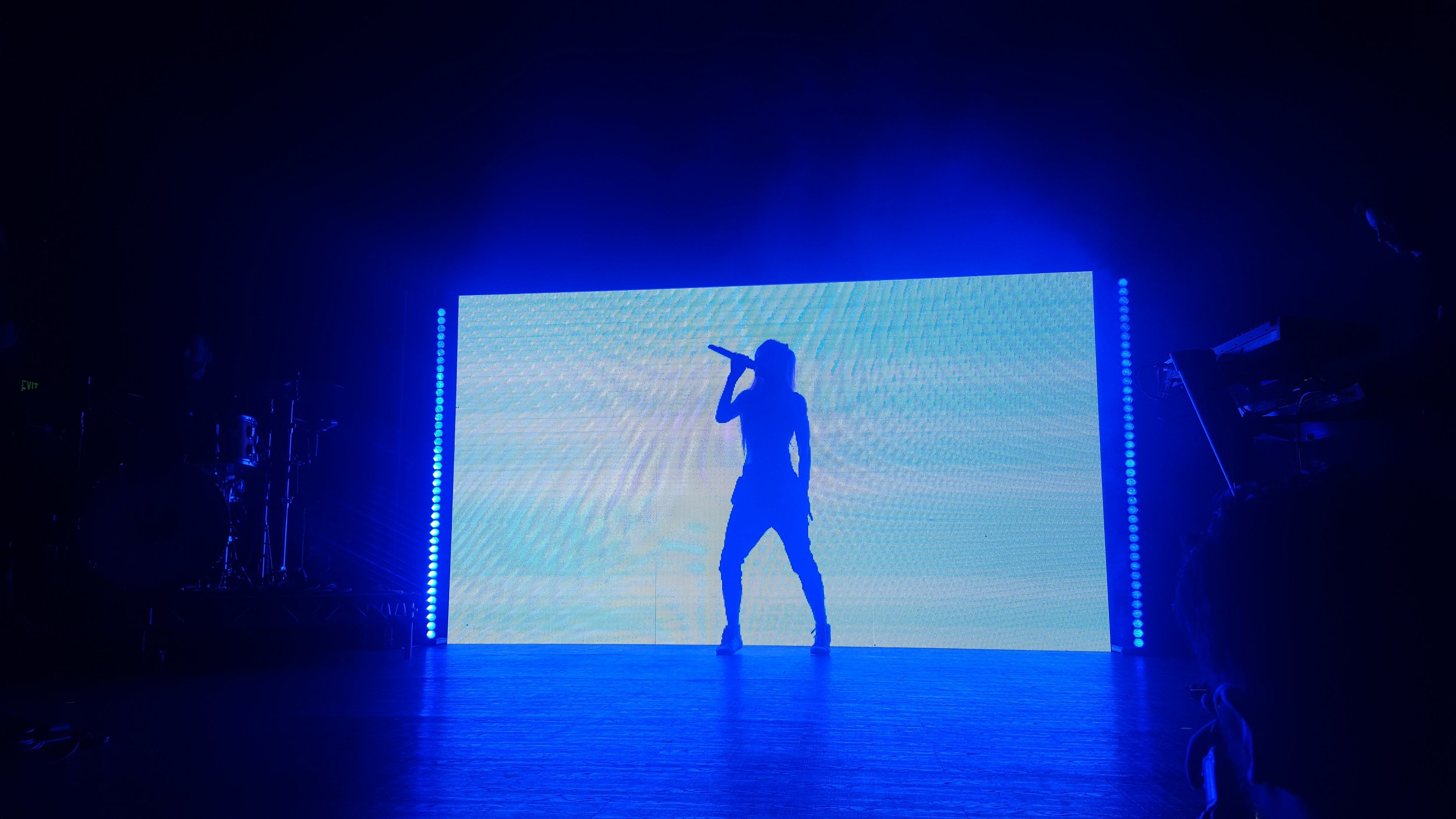 "Lights' silhouette sings the first song on the set, ""New Fears."""