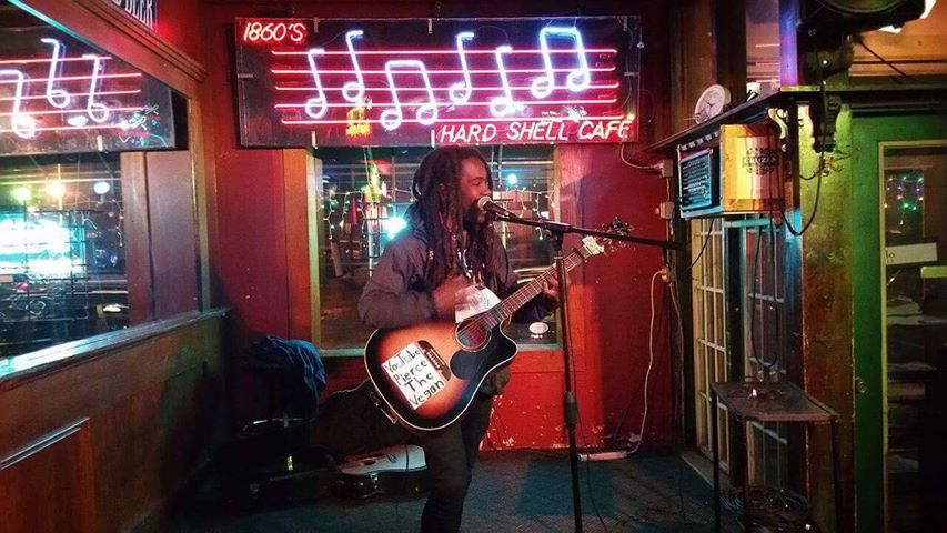 Photographed by Music Mark Z. Webb plays with a smile at 1860 Saloon in St. Louis.