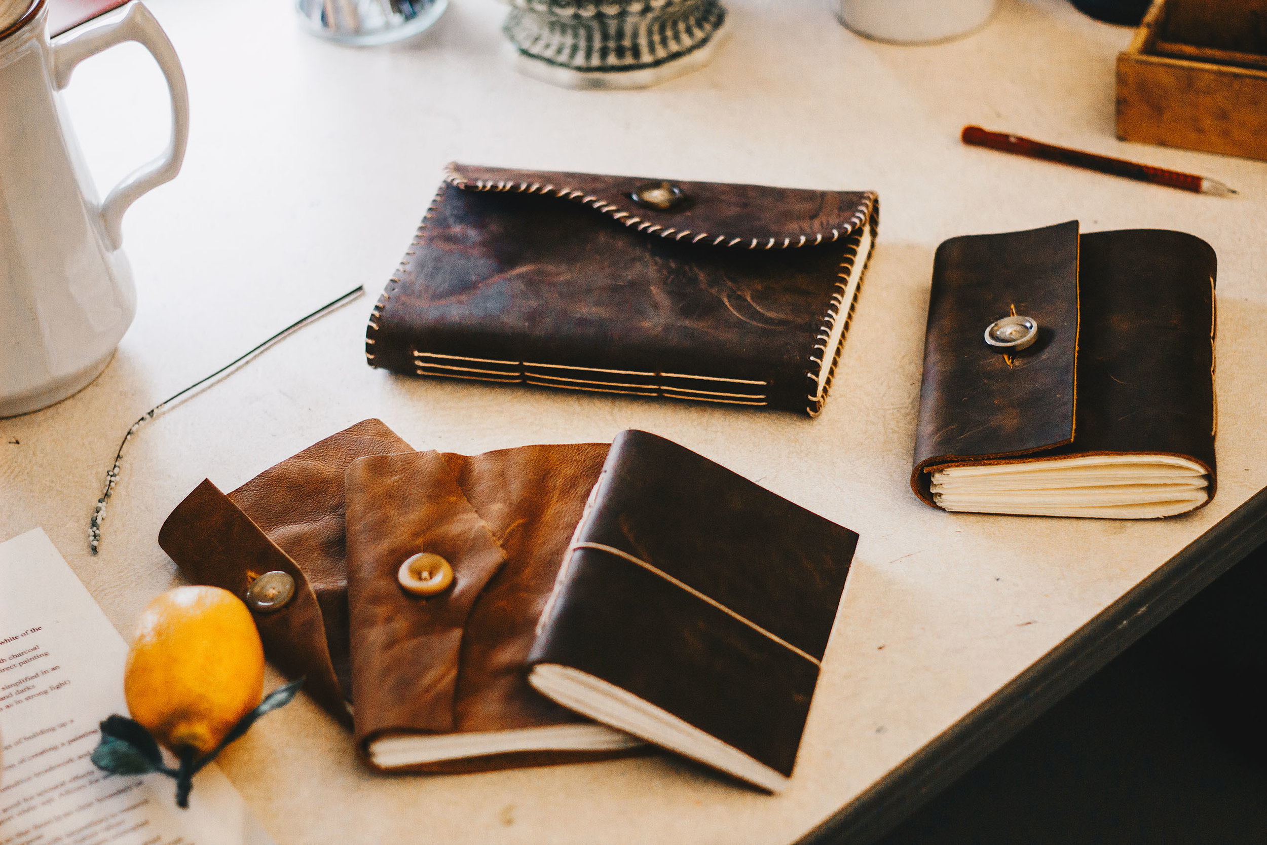 Handmade Leather-bound books made by Daniel Price. Photo by Art Director, Shelby Clayton