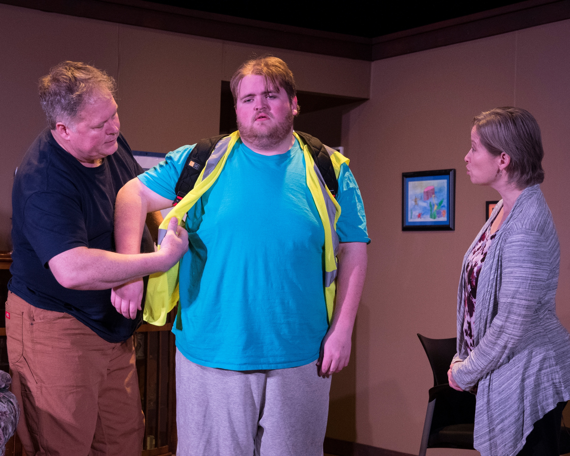 Josh's parents help him get ready for school. Josh is portrayed by Jack Janssen, while his parents are portrayed by Chrissy Calkins Steele and Geoff Callaway. Photographed by Kim Howland.