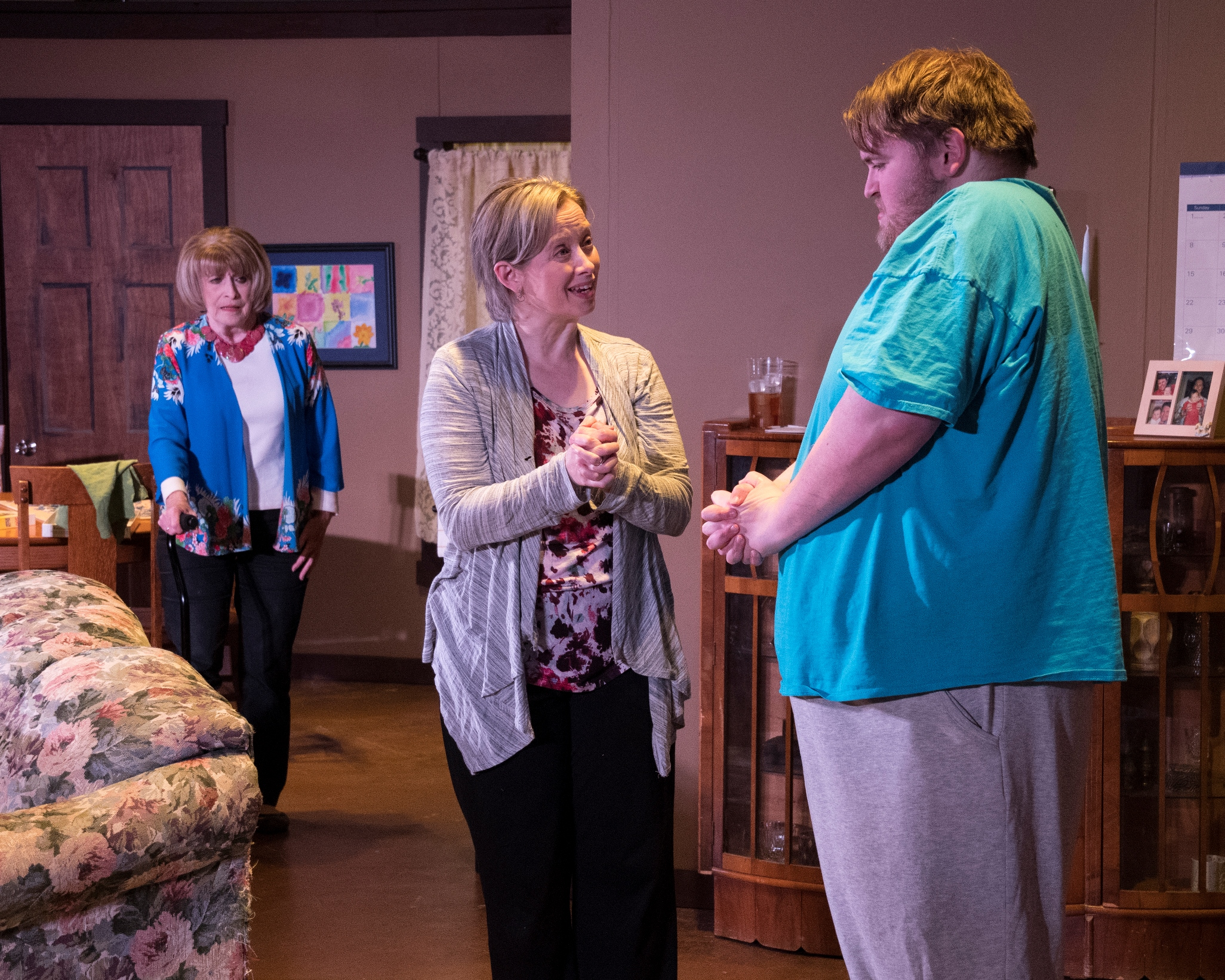 Tami, Josh's mother, helps Josh calm down in front of Grammy Sue, portrayed by Tommy Nolan. Photographed by Kim Howland.