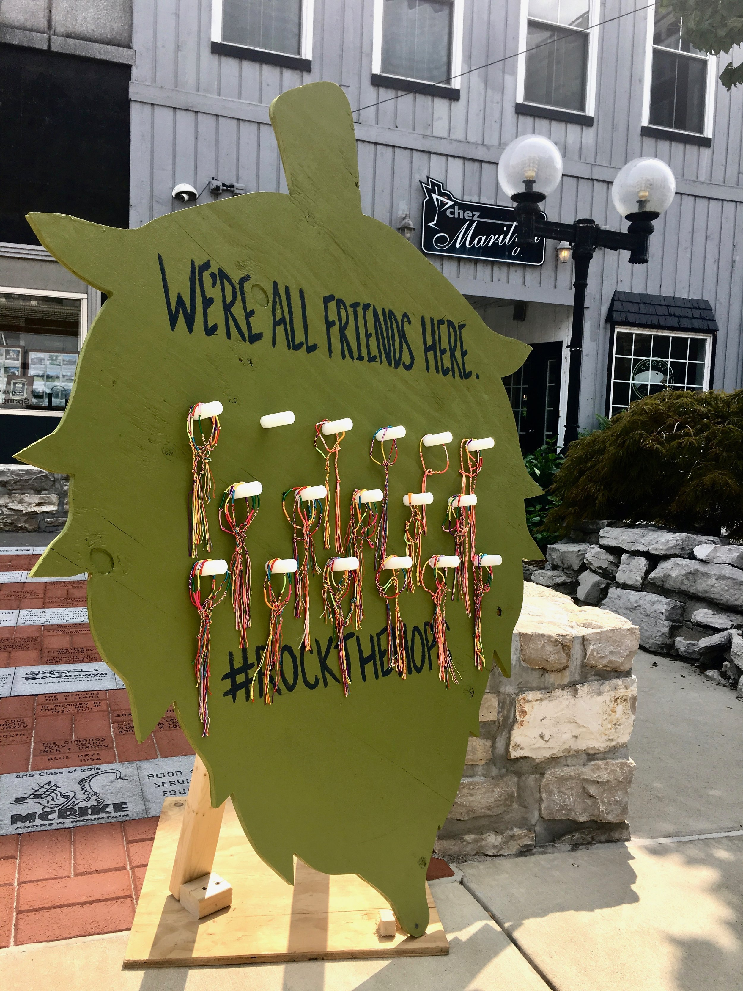 Before entering businesses hosting Rock the Hops, people could pick up and wear a free friendship bracelet, welcoming all. Photo by Rosita