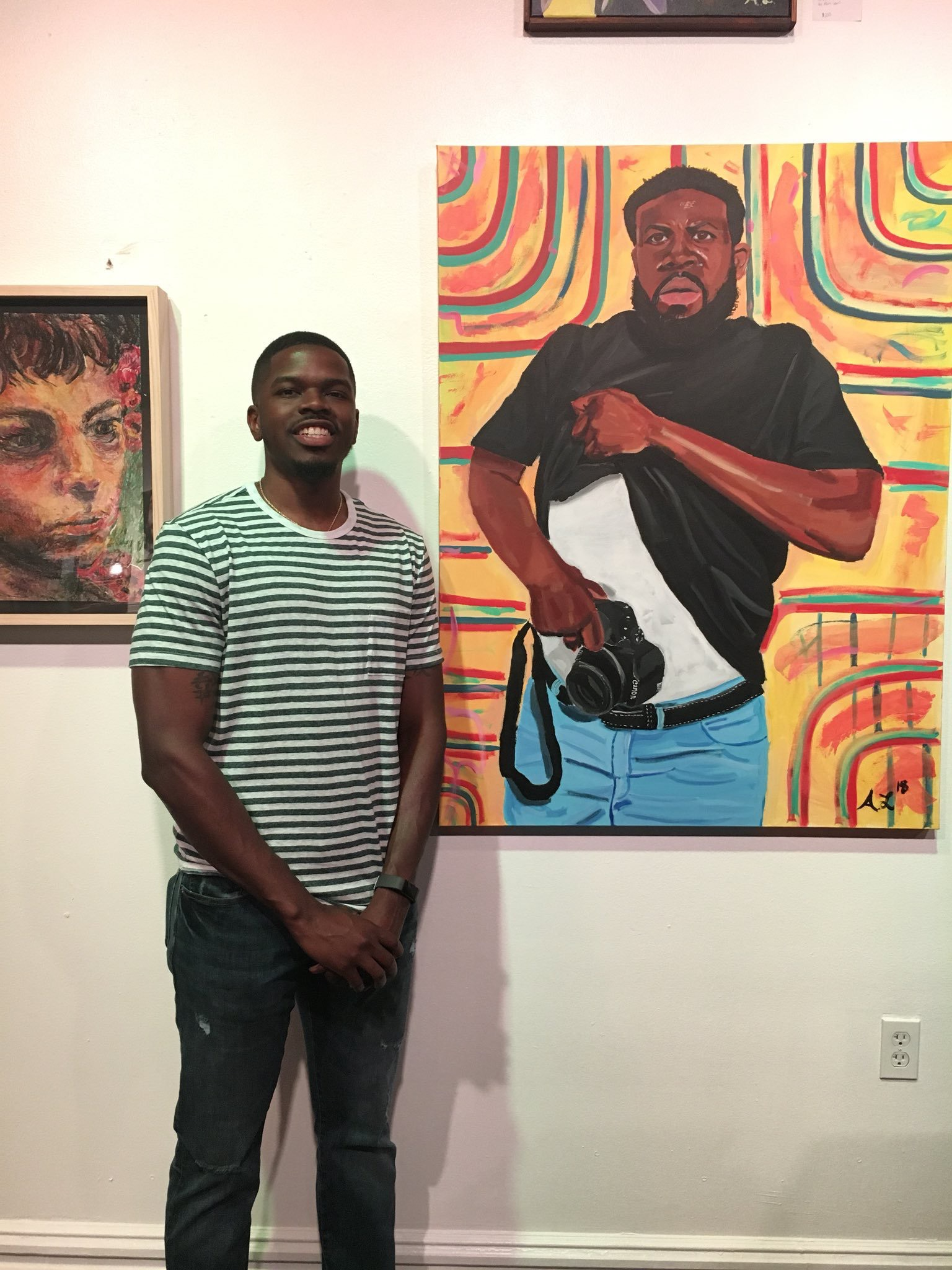"""Lewis with another piece titled """"Shooter."""" Photo provided by Alvin J. Lewis"""
