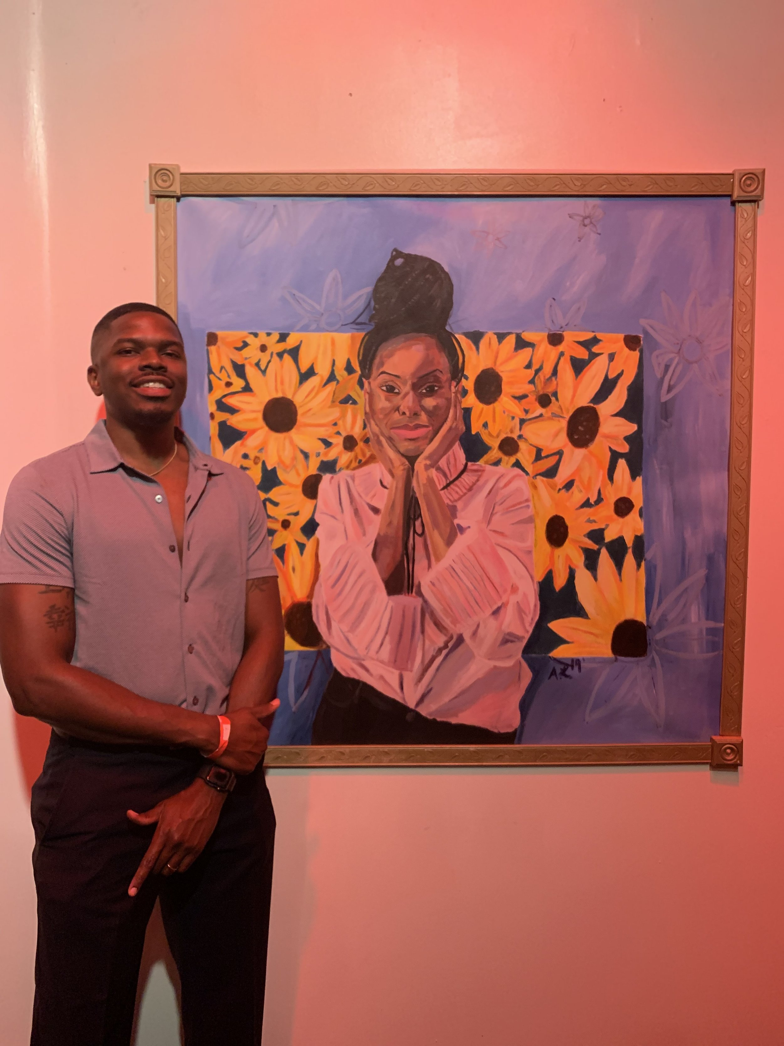 """Alvin J. Lewis with his acrylic piece called """"Untitled."""" Photo provided by Alvin J. Lewis"""