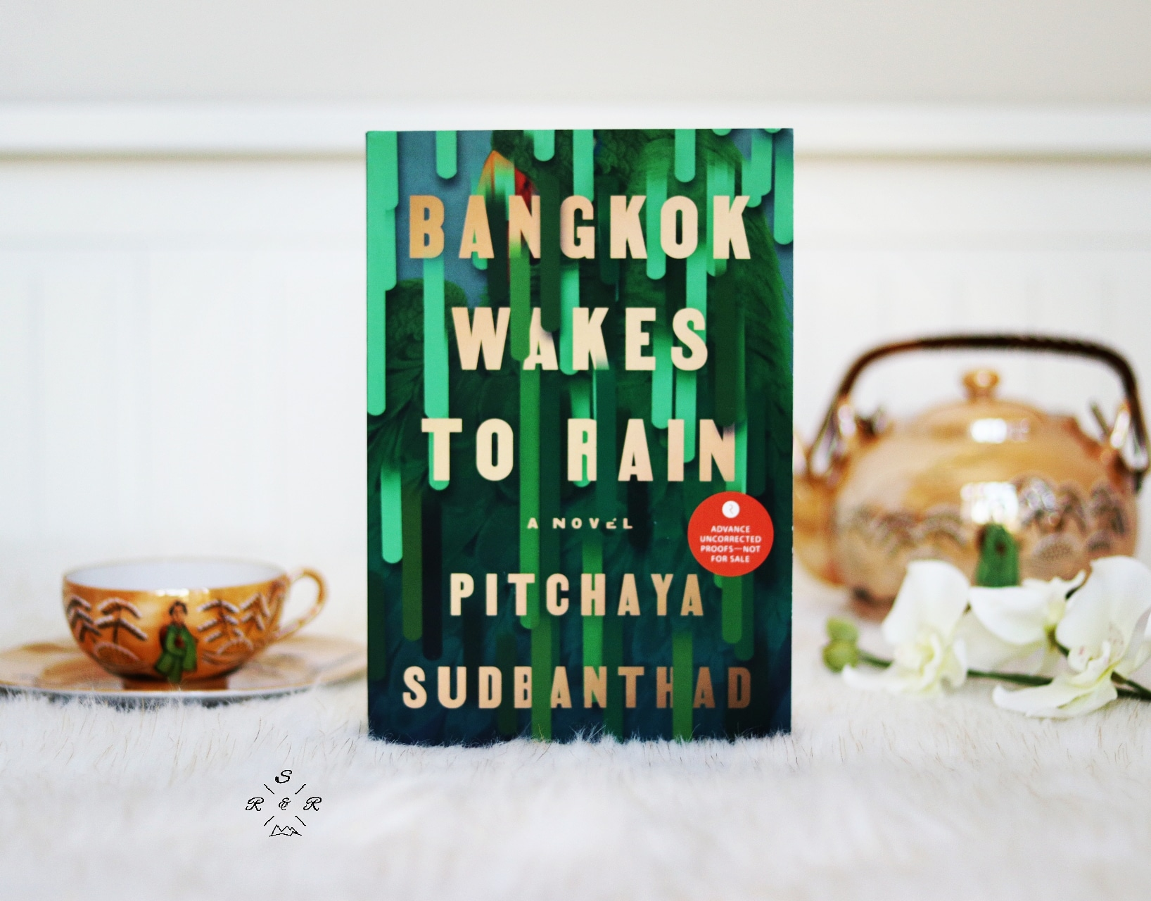 Bangkok Wakes to Rain - A missionary doctor pines for his native New England even as he succumbs to the vibrant chaos of nineteenth-century Siam. A post-World War II society woman marries, mothers, and holds court, little suspecting her solitary fate. A jazz pianist in the age of rock, haunted by his own ghosts, is summoned to appease the house's resident spirits. In the present, a young woman tries to outpace the long shadow of her political past. And in a New Krungthep yet to come, savvy teenagers row tourists past landmarks of the drowned old city they themselves do not remember. Time collapses as these lives collide and converge, linked by the forces voraciously making and remaking the amphibious, ever-morphing capital itself. Bangkok Wakes to Rain is an elegy for what time erases and a love song to all that persists, yearning, into the unknowable future.