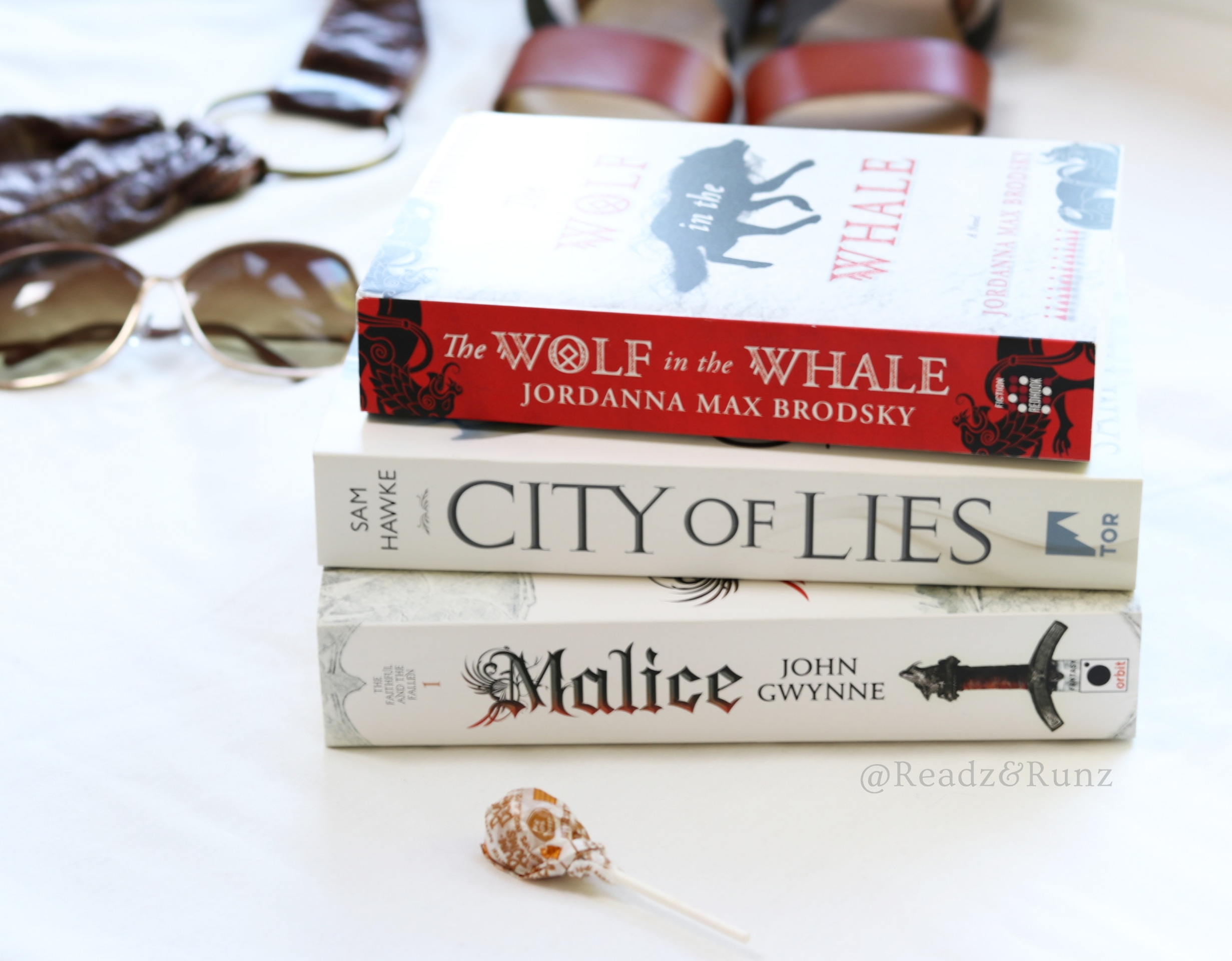 The top 3 contenders :) - With me I hauled these beauties.I'm not gonna lie, I did not read as much during the visit as anticipated. Mostly the travel time gave me the opportunity for lot's of reading :)I finished Malice and am still reading City of Lies.