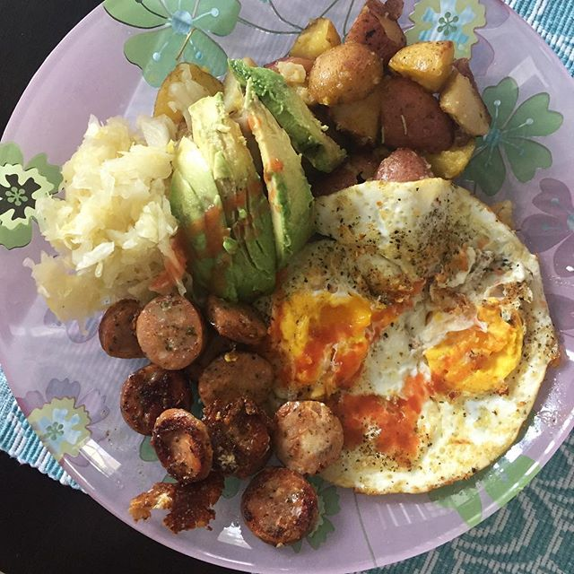 Now THIS is a big breakfast! . No shame whatsoever eating this giant plate of food....I love a big breakfast and this is pretty typical meal for me. . Two fried eggs, roasted potatoes, 1/2 an avocado, sauerkraut, and a sautéed chicken sausage. Plus some hot sauce and a plethora of spices. 🍳 . I never count calories, macros or weigh my food. I eat big ass meals like this, I feel great and I move on. I make sure I have protein (eggs and sausage), fat (avocado, olive oil from roasted potatoes, ghee to cook the eggs in), and carbs (potatoes) and I base my meals off this simple template. Plus some gut healing fermented foods (sauerkraut) and I'm ready to start the day! 😏 . . . . . #nutrition #science #breakfast #brunch #vitamins #minerals #essentialnutrients #health #realfood #paleodiet #paleotricks #paleotips #cleaneating #nutrients #jerf #healthy #healthyliving #healthylivingtips #health #vegetables #fat #protein #carbohydrates #glutenfree #grainfree #dairyfree #healthyblogger #nutritioncoach #stopcountingcalories #micronutrientsmatter #micronutrientcounting