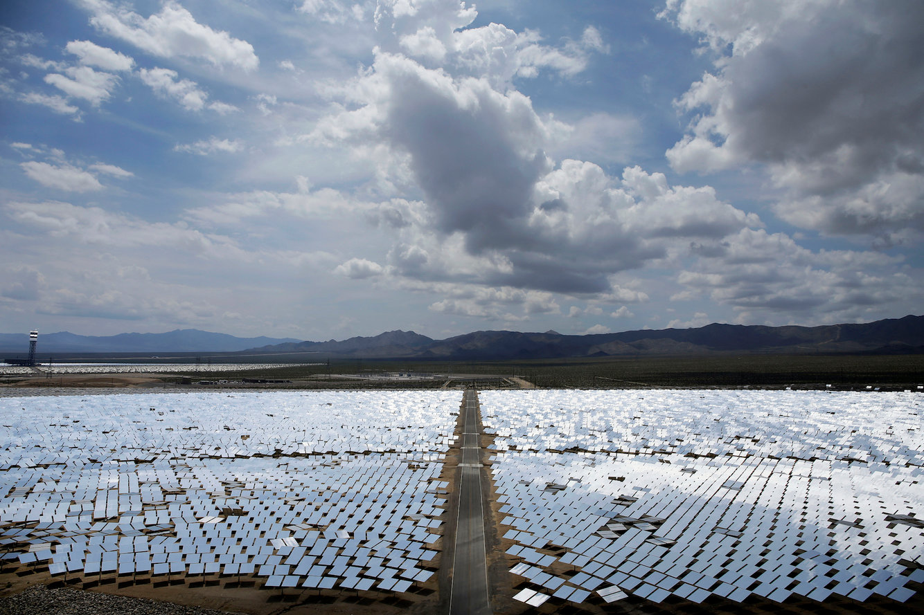 This Aug. 13, 2014, file photo, shows an array of mirrors at the Ivanpah Solar Electric Generating site in Primm, Nev -- AP Photo/John Locher