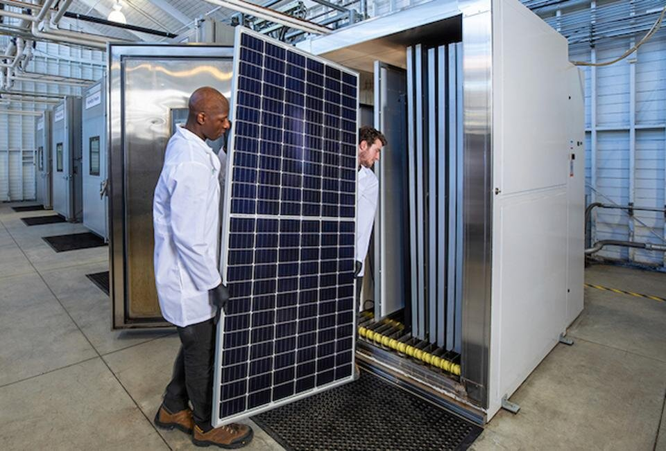 Bringing a module into an environmental chamber for accelerated testing [via forbes.com]